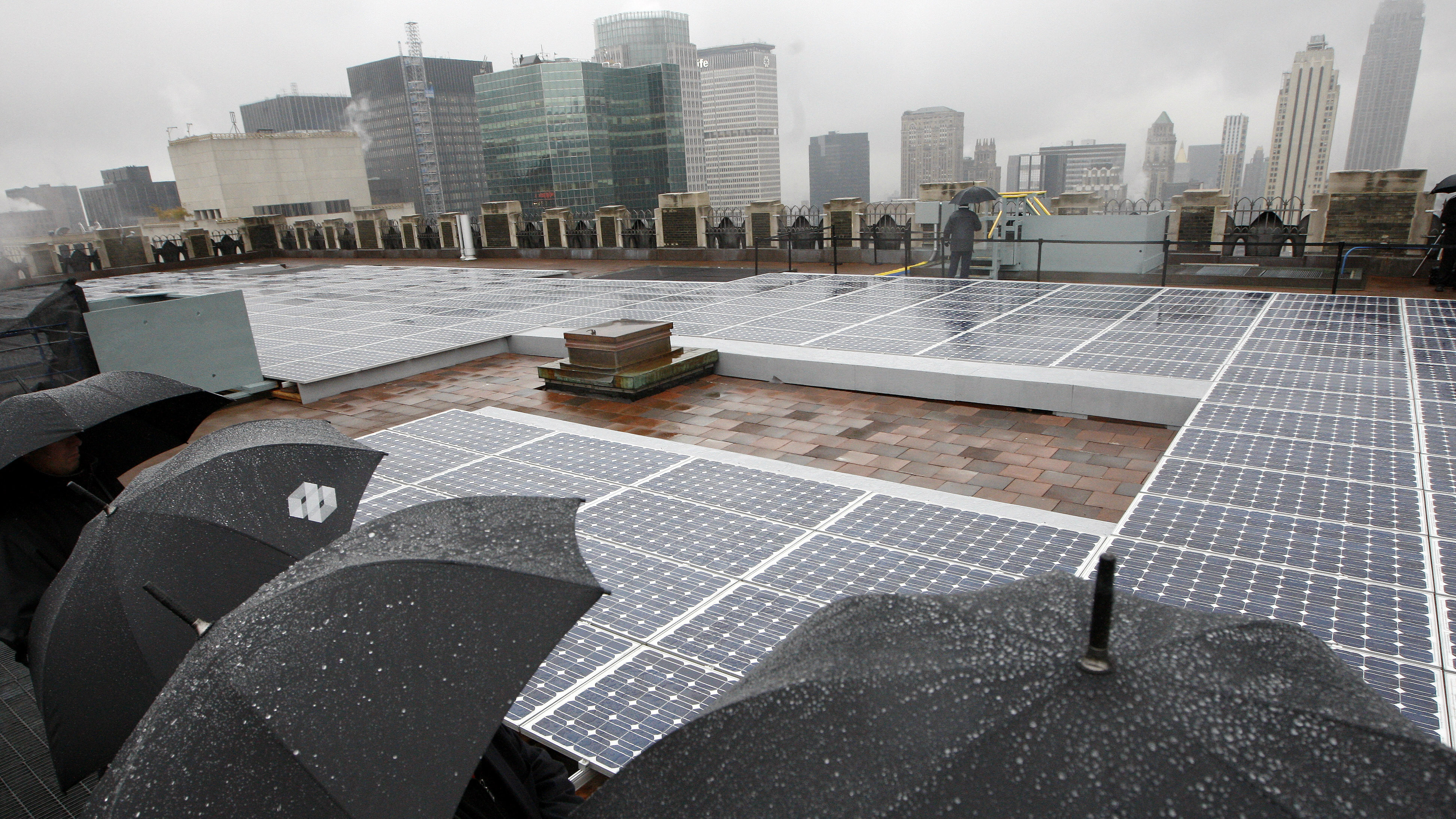 Rain pours as the largest privately owned solar roof in Manhattan was unveiled, atop 45 Rockefeller Plaza, with the capacity to generate 70 kilowatts of DC electricity, in New York, November 20, 2007.