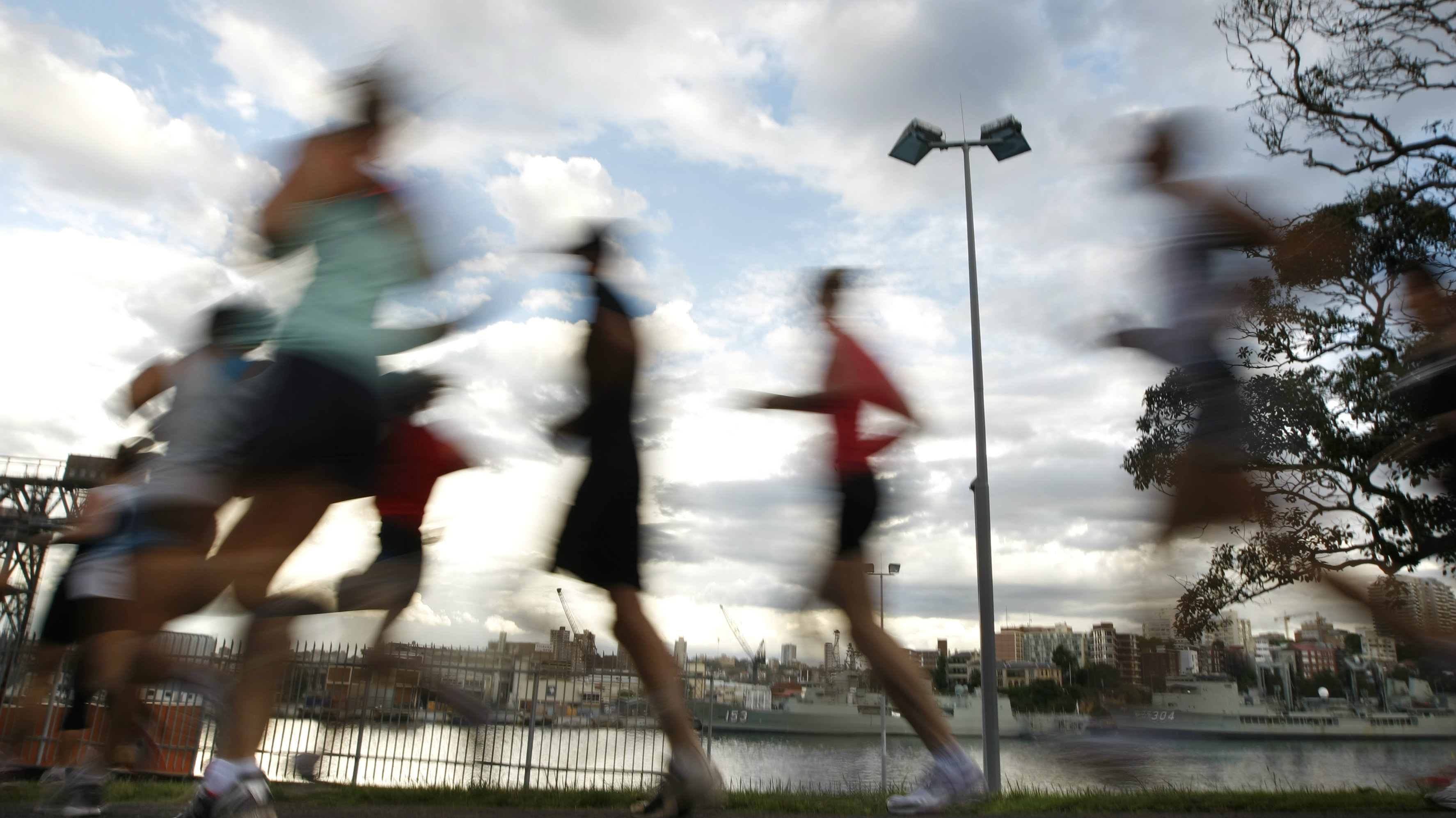 Runners participate in a weekly, after-work biathlon at The Domain adjacent to Sydney's central business district November 20, 2008.