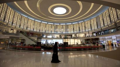 A shopper goes about her business in Dubai Mall in Dubai December 2, 2009.