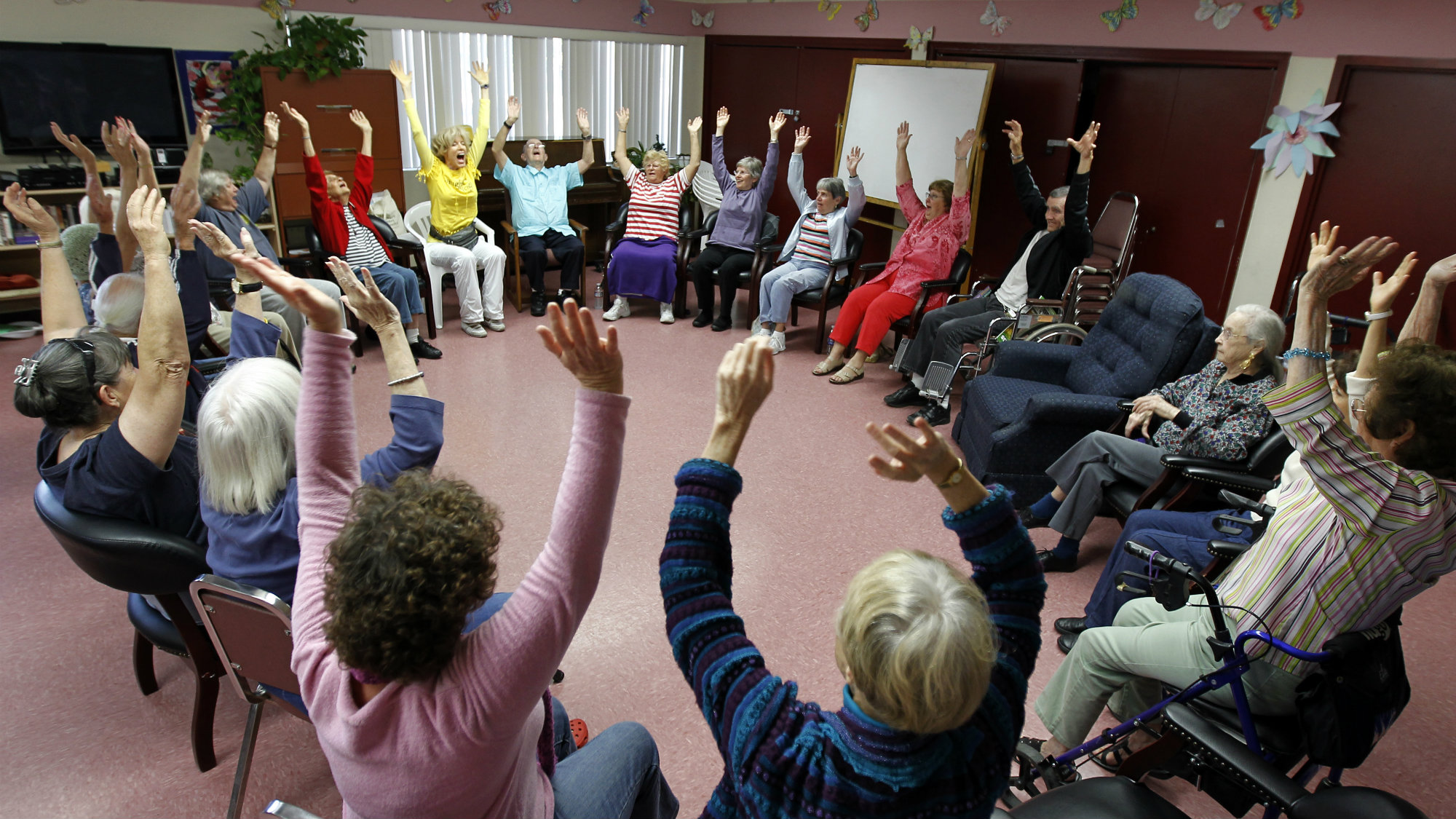 Dr. Funshine, aka Caroline Meeks, M.D. teaches a laughter therapy class to a group of seniors at the Clairmont Friendship Center in San Diego, California.
