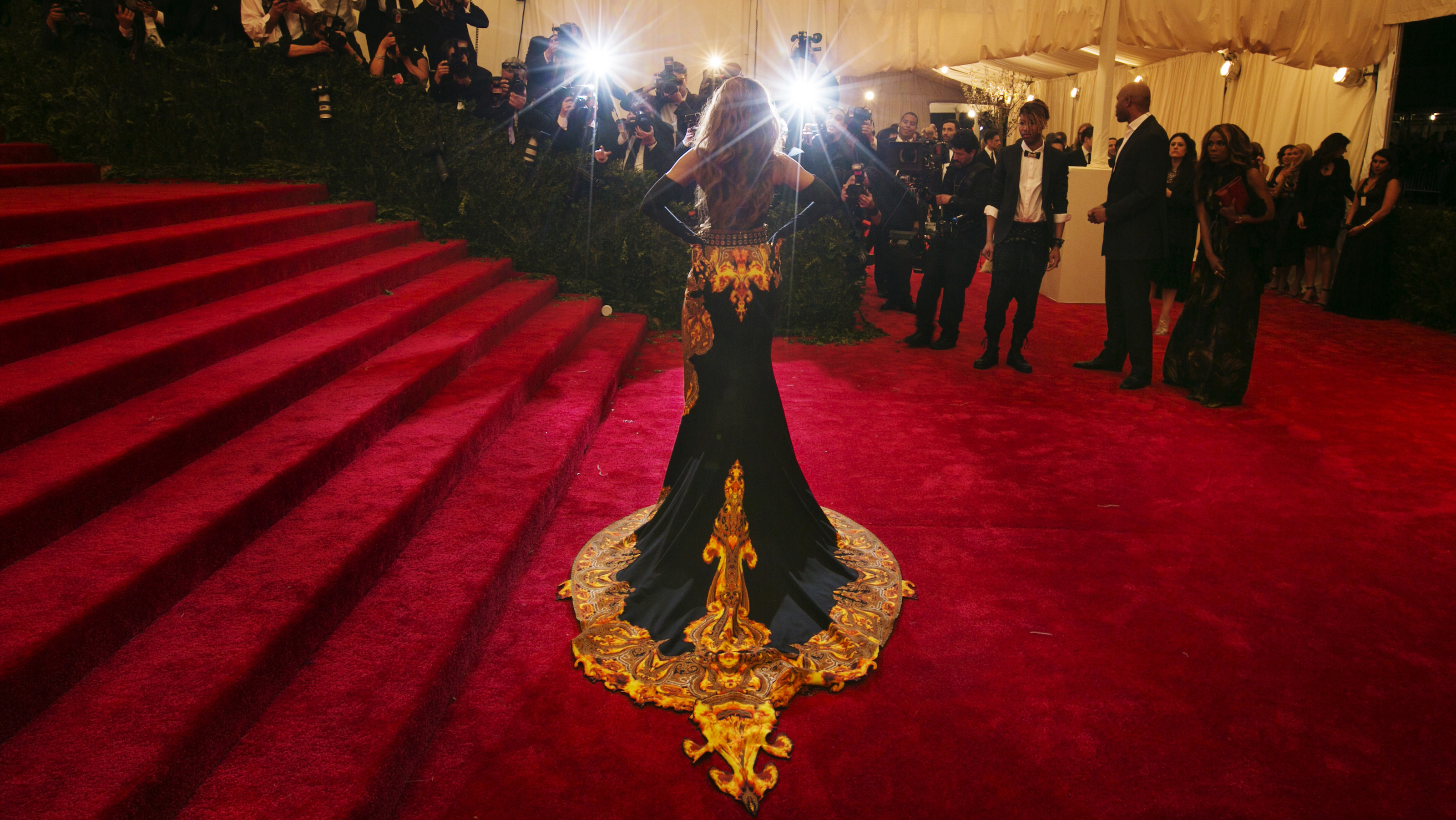 """Singer Beyonce arrives at the Metropolitan Museum of Art Costume Institute Benefit celebrating the opening of """"PUNK: Chaos to Couture"""" in New York, May 6, 2013. REUTERS/Lucas Jackson (UNITED STATES - Tags: ENTERTAINMENT FASHION TPX IMAGES OF THE DAY) - RTXZD0U"""