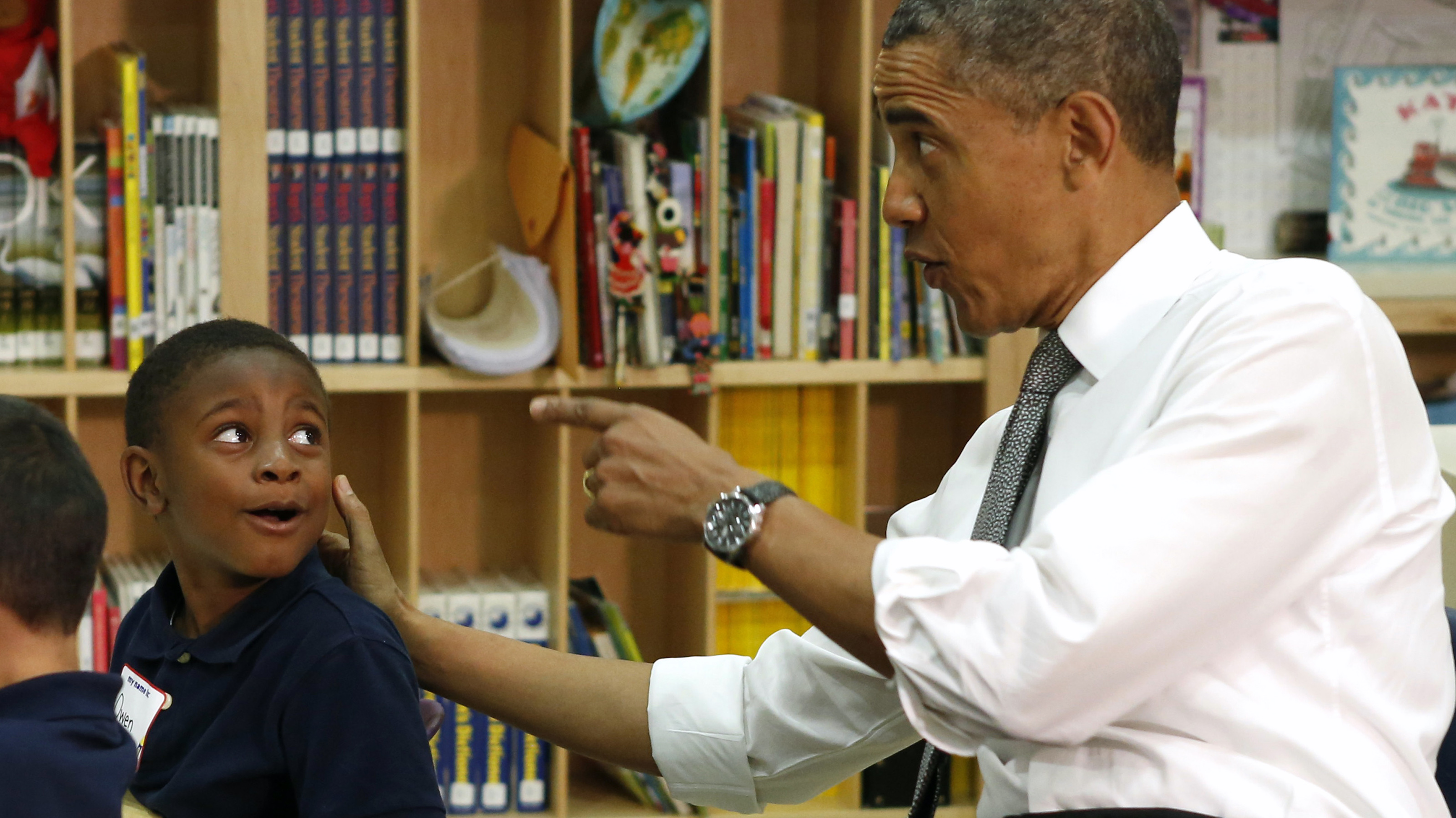 U.S. President Barack Obama talks with a pre-kindergarten student at Moravia Park Elementary School during his second 'Middle Class Jobs and Opportunity Tour' in Baltimore, Maryland May 17, 2013. REUTERS/Kevin Lamarque   (UNITED STATES - Tags: POLITICS EDUCATION TPX IMAGES OF THE DAY) - RTXZQO8