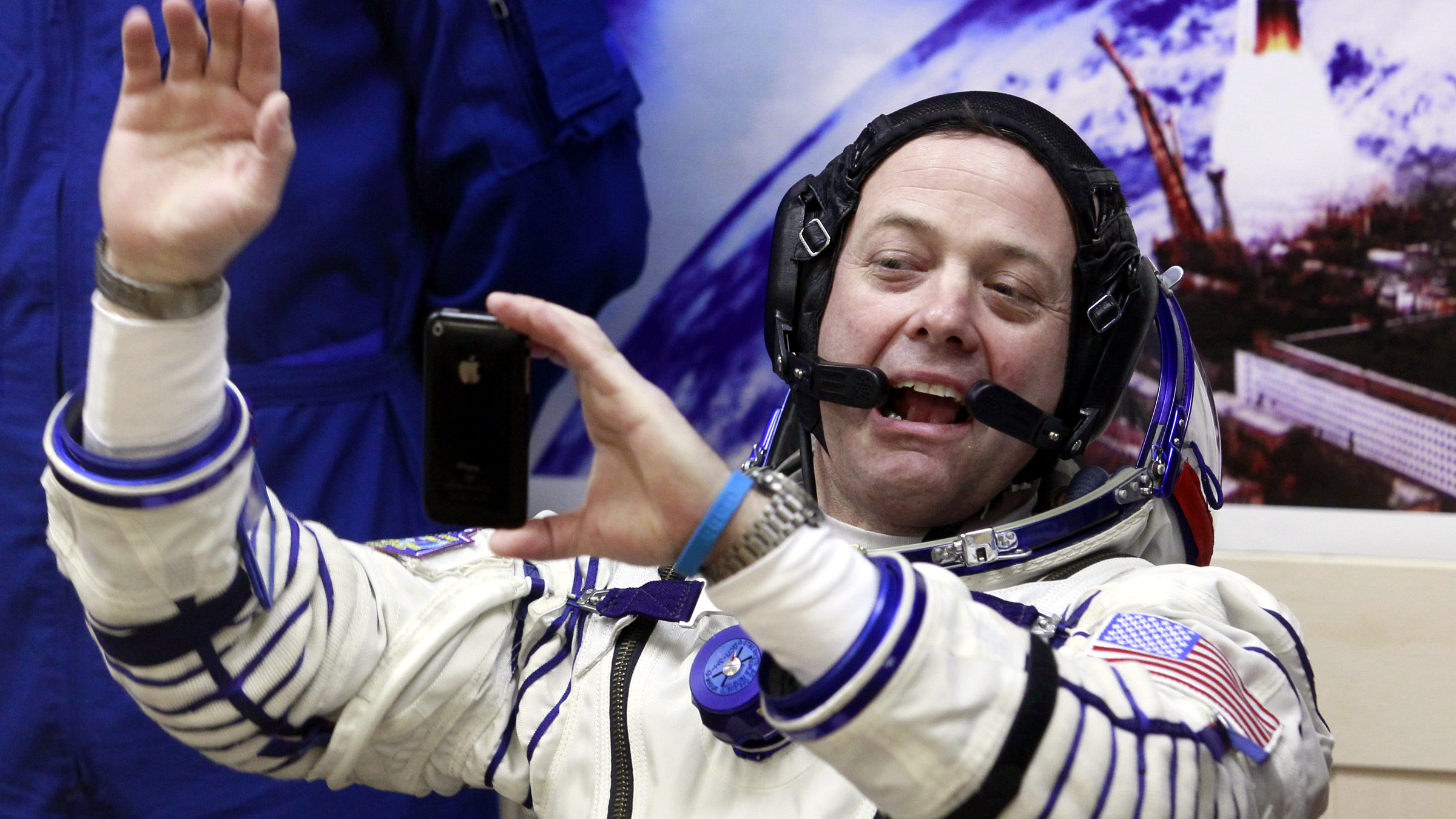 U.S. astronaut Ron Garan, crew member of the mission to the International Space Station, ISS, takes a photo of himself by mobile phone prior to the launch of Soyuz-FG rocket at the Russian leased Baikonur cosmodrome, Kazakhstan, Tuesday, April 5, 2011.