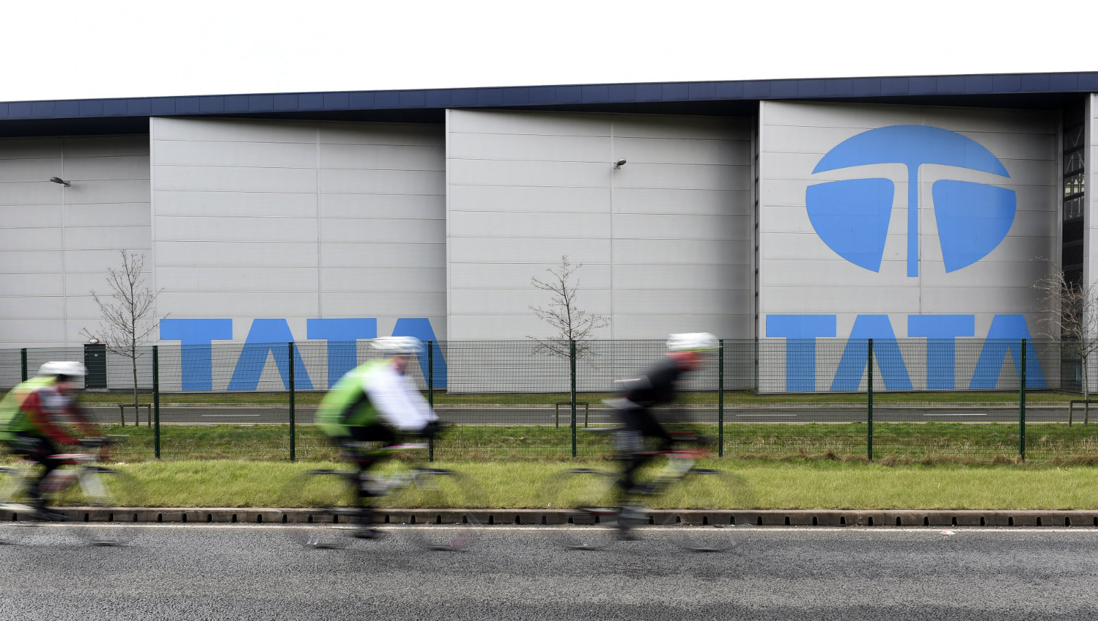 Cyclists ride past the Tata steelworks in the town of Port Talbot, Wales, Britain March 30, 2016.