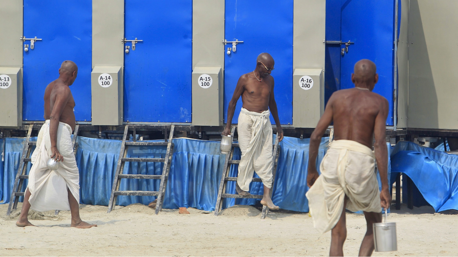 A man comes out from a temporary toilet installed on the banks of the Ganges river in Allahabad, India, February 26, 2016.
