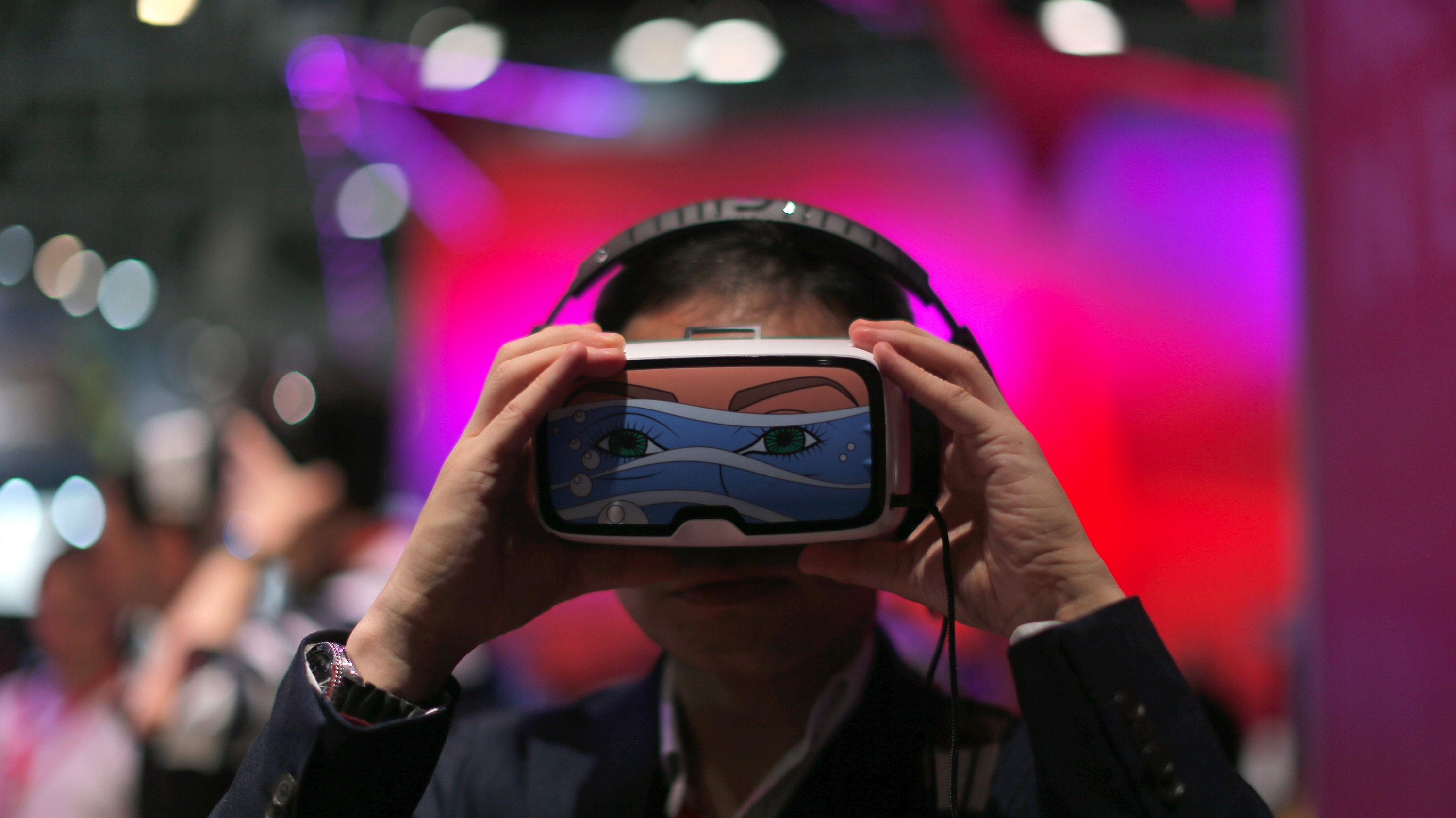 A man uses a virtual reality device during the Mobile World Congress wireless show in Barcelona, Spain, Tuesday, Feb. 23, 2016. (AP Photo/Manu Fernandez)