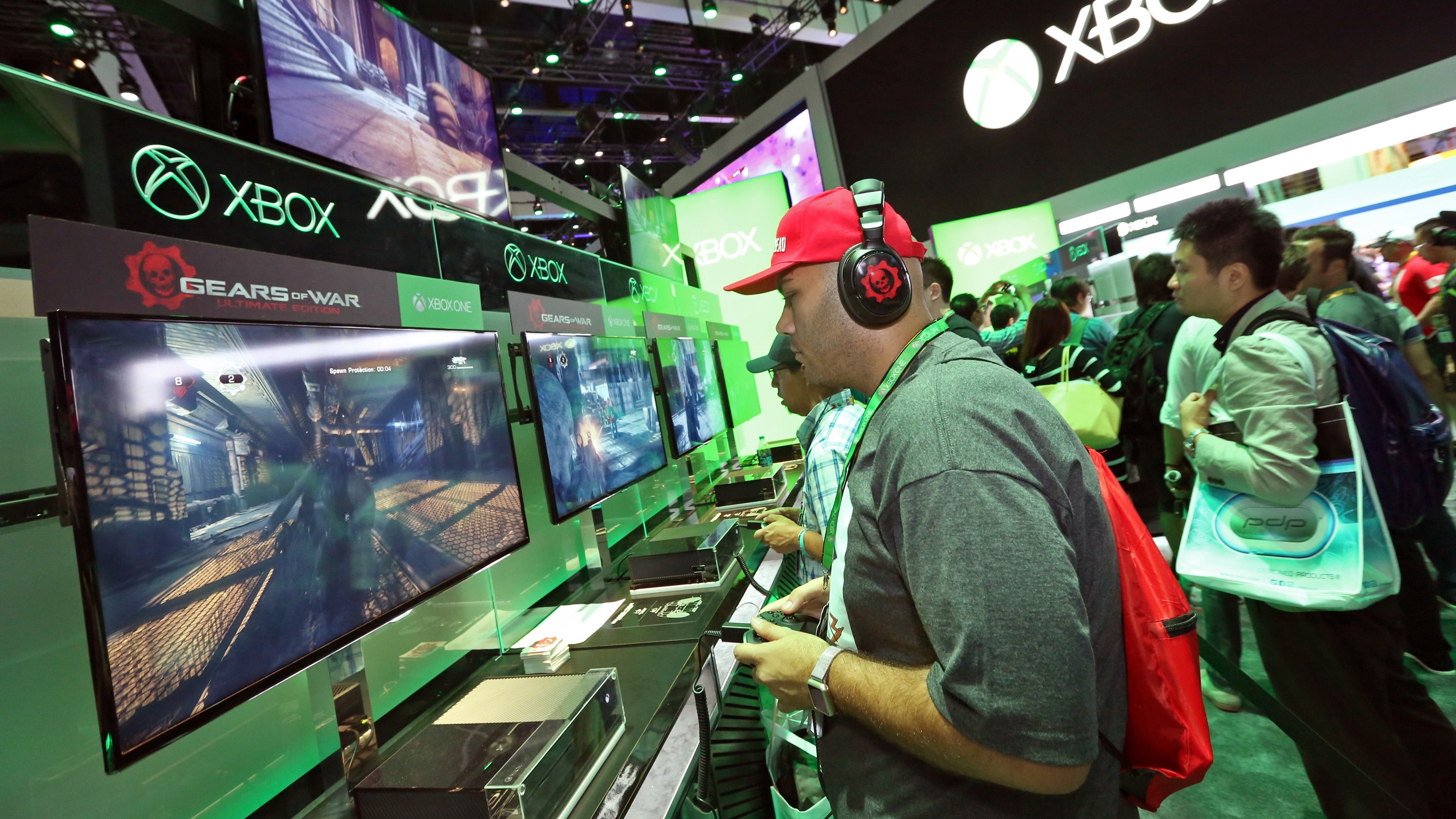 IMAGE DISTRIBUTED FOR MICROSOFT - E3 2015 attendees get hands on with Gears of War Ultimate Edition at the Xbox booth at E3 in Los Angeles on Tuesday, June 16, 2015. (Photo by Casey Rodgers/Invision for Microsoft/AP Images)