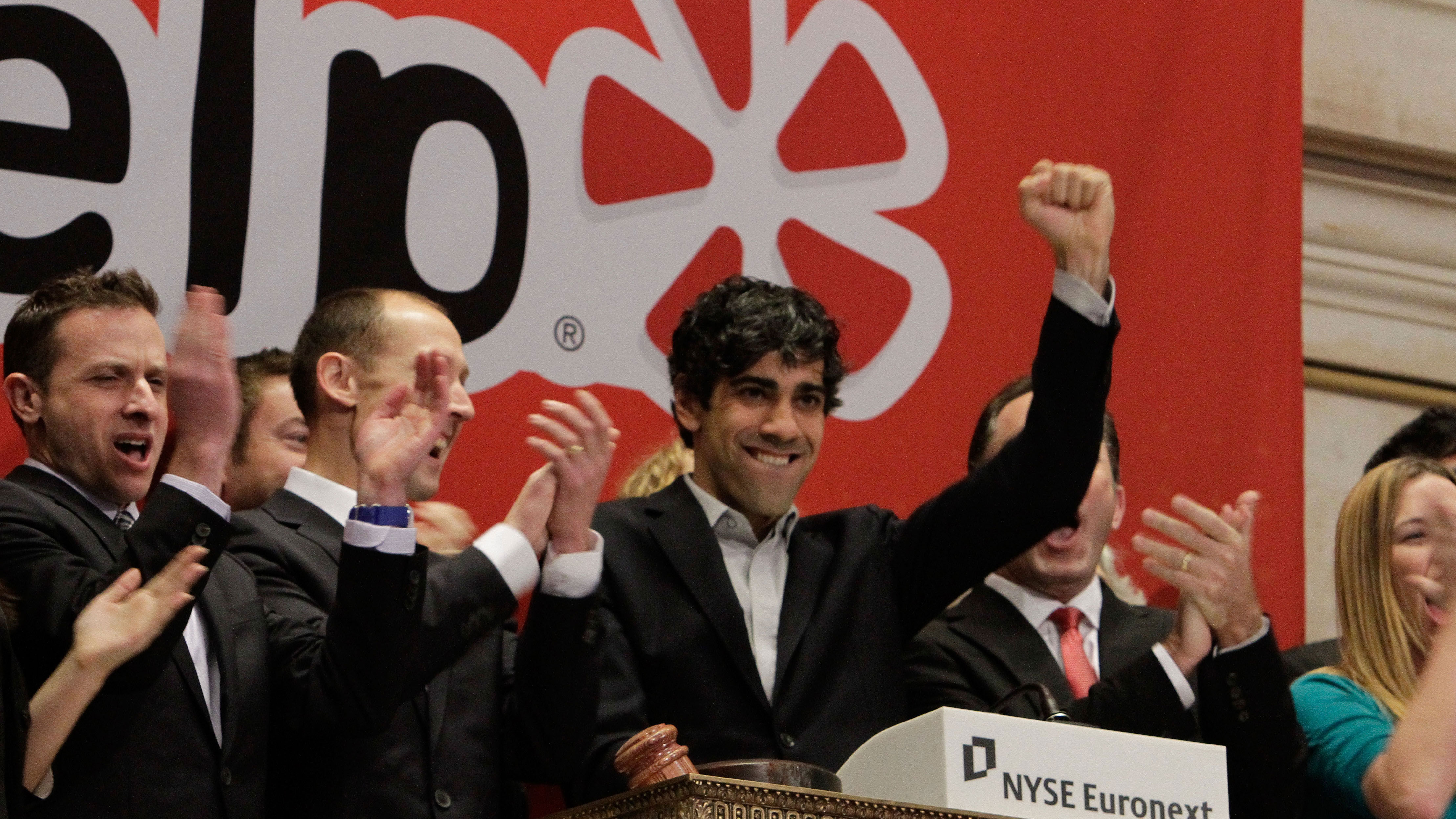 FILE - In this March 2, 2012 file photo, Jeremy Stoppelman, right center, Yelp co-founder and CEO, salutes during opening bell ceremonies of the New York Stock Exchange. The market for initial public offerings is heating up this spring as a better economic outlook and rising stock market help more companies go public. In the weeks before Facebook's massive IPO, two companies have already notched the biggest debuts since LinkedIn went public in May. Congress, meanwhile, is lessening restrictions on IPOs to make it easier for smaller companies to raise money. The IPO comeback may finally be happening. (AP Photo/Richard Drew, File)