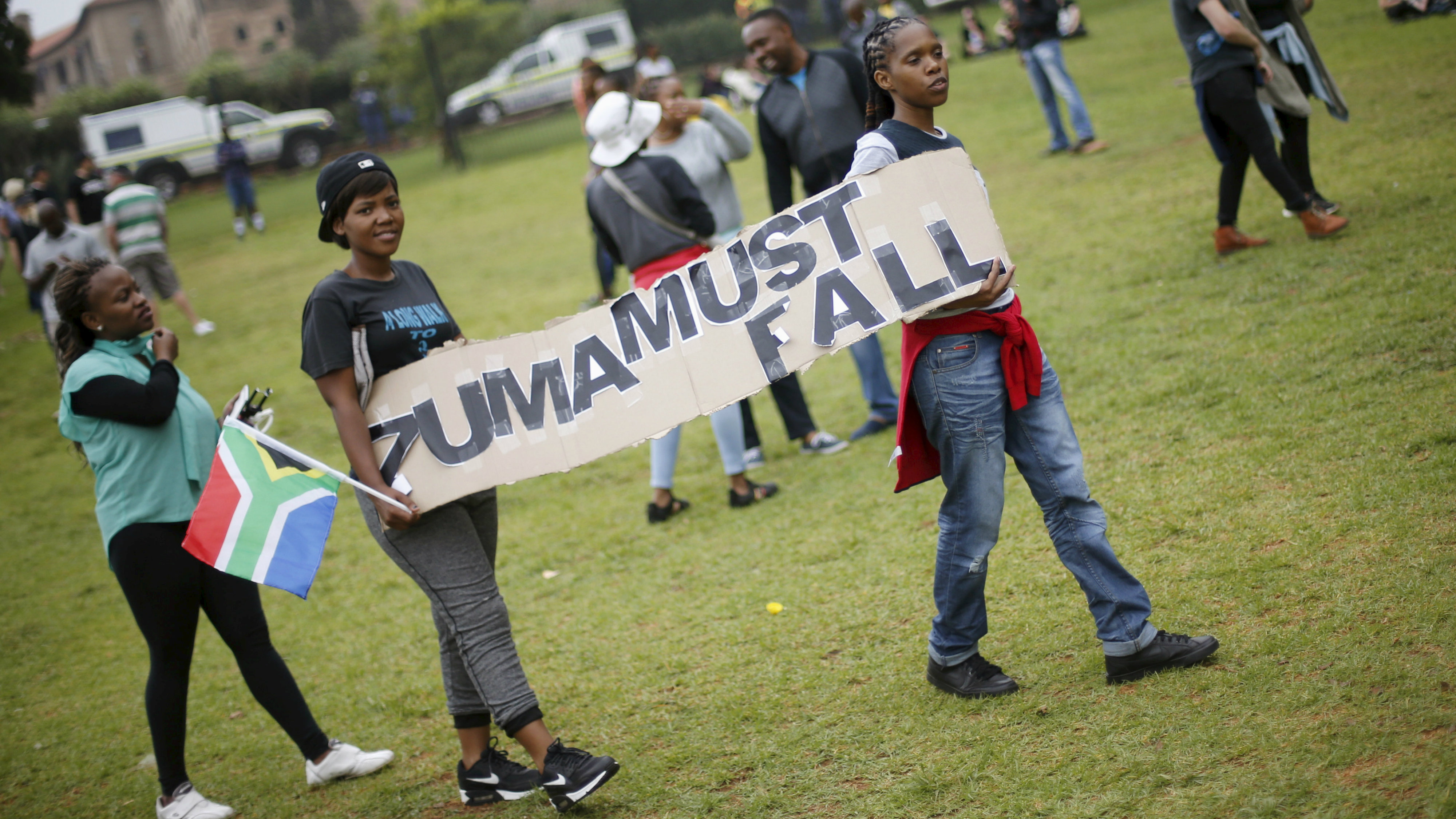 Protesters carry placards as they take part in a 'Zuma must fall' demonstration in Pretoria, South Africa December 16, 2015