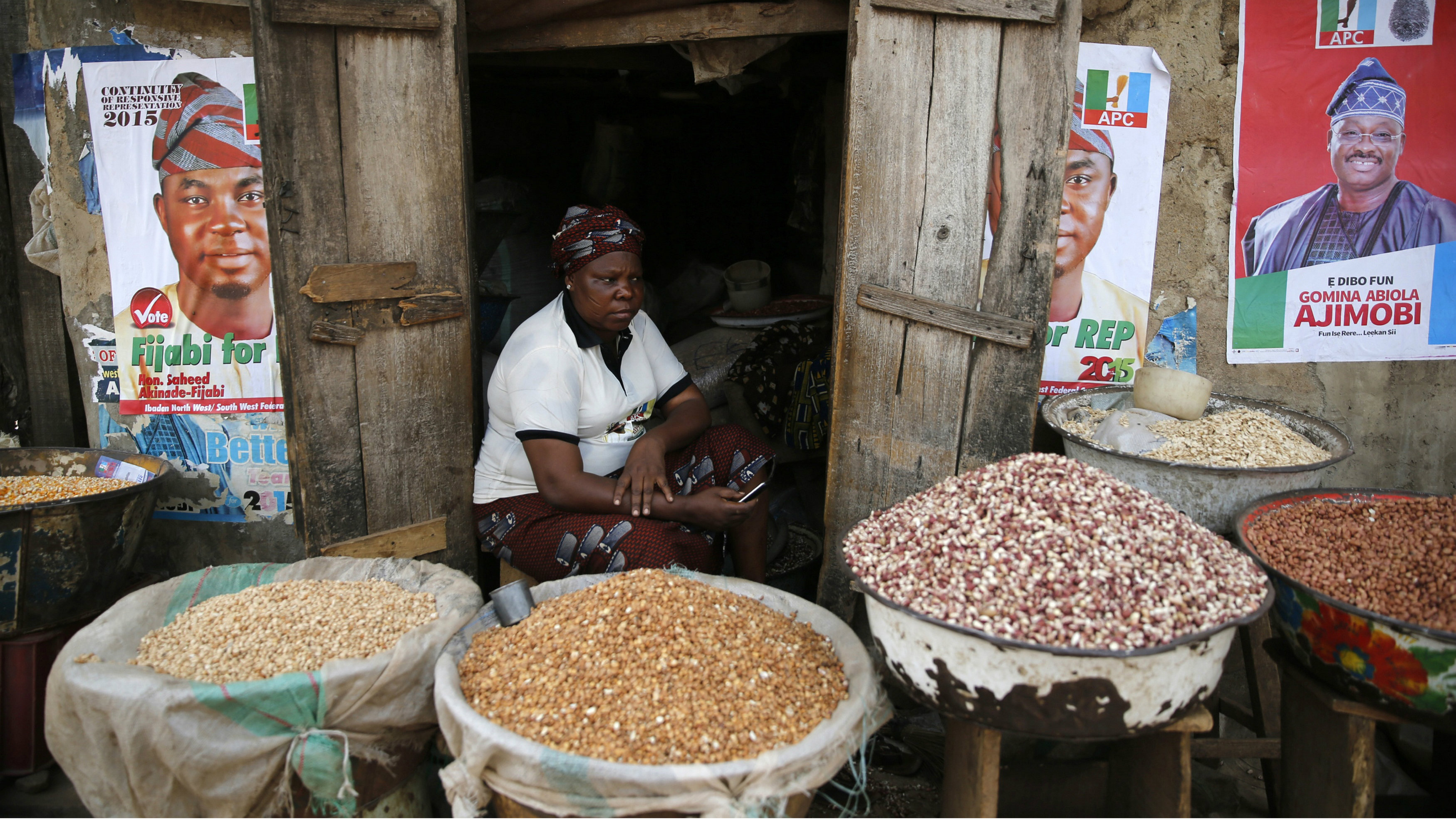 Latefat Alao, 56, a ethnic Yoruba Muslim woman, waits for customers in front of her in Beere market in Ibadan, southwest Nigeria, January 29, 2015.