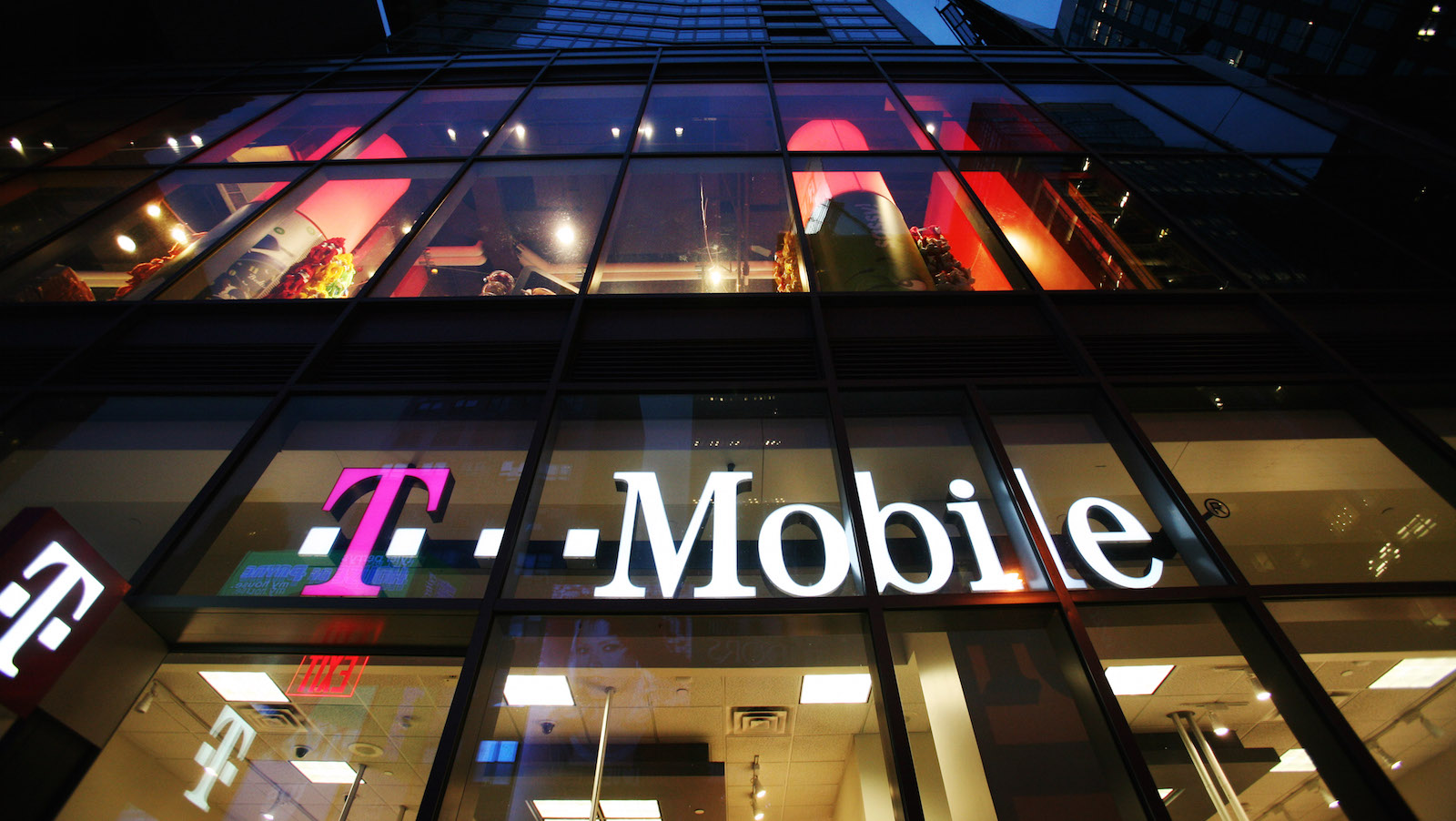 In this March 18, 2008 photo, a T-Mobile retail store is shown in Times Square in New York.  T-Mobile USA Inc. announced Thursday, March 22, 2012, that it is cutting 1,900 jobs nationwide as it consolidates its call centers in an effort to cut costs and remain competitive. The jobs represent nearly half of the total number of people it employs at its call centers. (AP Photo/Mark Lennihan)