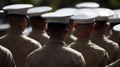 A group of US Marines march in a parade honoring Japanese American WWII veterans, Saturday, Dec. 17, 2011 in Honolulu.