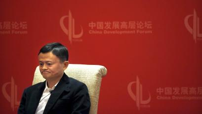 In this March 19, 2016 photo, Jack Ma, executive chairman of the Alibaba Group, listens to a speaker during a panel discussion held as part of the China Development Forum at the Diaoyutai State Guesthouse in Beijing. The International Anti-Counterfeiting Coalition's decision to welcome Chinese e-commerce giant Alibaba as a new member - and allow founder Jack Ma to make the keynote speech at its May 2016 conference - so incensed the U.S. luxury retailer Michael Kors that it severed its longstanding connection with the Washington-based industry group.