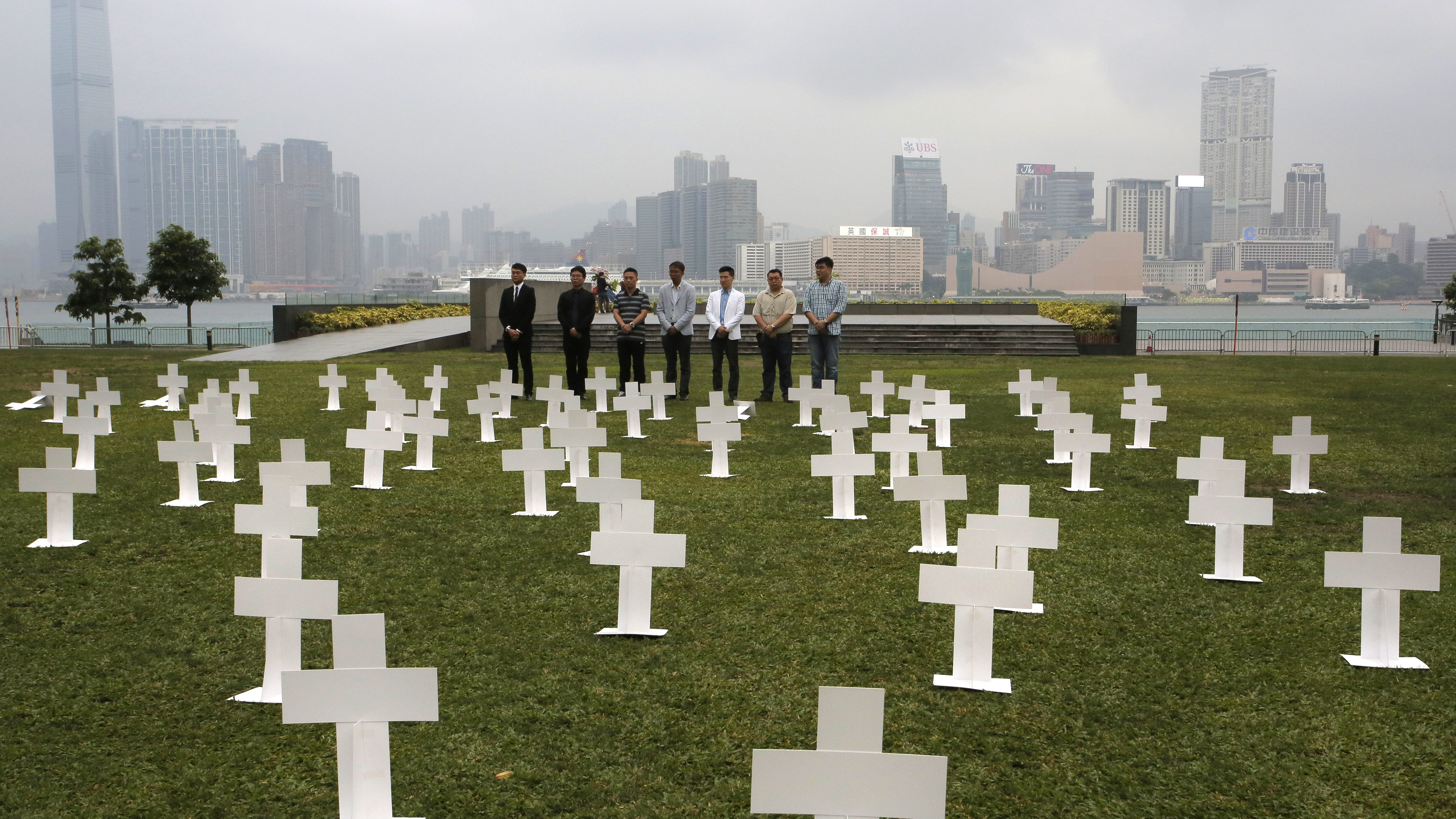 Protesters set up paper grave markers during a protest to against the visit of Zhang Dejiang, chairman of China's National People's Congress, to Hong Kong, Tuesday, May 17, 2016. Hong Kong authorities rolled out a massive security operation on Tuesday as they brace for protests during a top Beijing official's visit to the semiautonomous city, which has been the scene of rising discontent with Chinese rule.Hong Kong, Tuesday, May 17, 2016. (AP Photo/Vincent Yu)