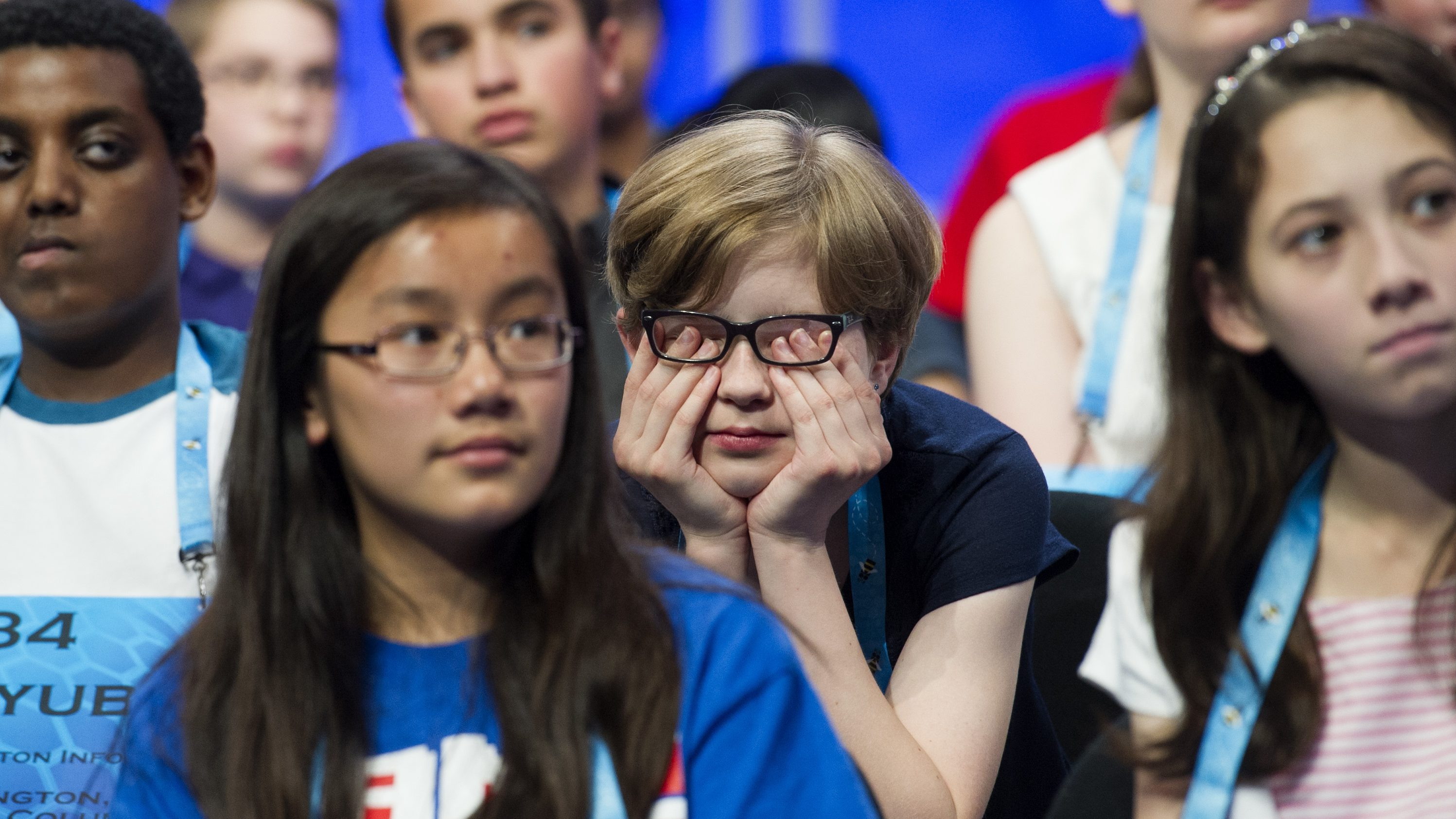 Ella Scheuermann, 11, from Grafenwoehr, Germany, rubs her eyes after sitting down following correctly spelling her word during the preliminary round three of the Scripps National Spelling Bee in National Harbor, Md., Wednesday, May 25, 2016. (AP Photo/Cliff Owen)