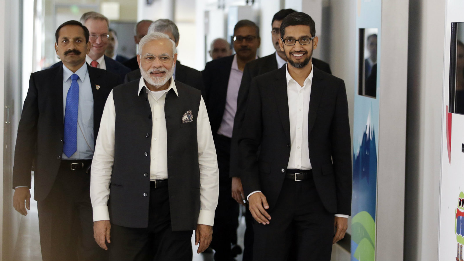 Prime Minister of India Narendra Modi, center, walks the hallways of Google headquarters alongside Google executive Sundar Pichai, at right, Sunday, Sept. 27, 2015, in Mountain View , Calif. After meeting with Facebook CEO Mark Zuckerberg at Facebook headquarters earlier, Modi scheduled meetings with the CEOs of Apple and Google during his whirlwind tour of Silicon Valley.