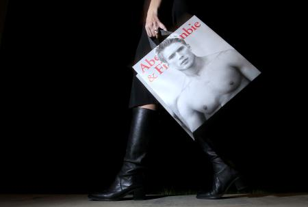 FILE - In this Nov. 14, 2011, file photo, a shopper carries her Abercrombie & Fitch purchase in Phoenix. Retailer Abercrombie & Fitch reports quarterly earnings on Friday, Nov. 20, 2015. (AP Photo/Ross D. Franklin, File)
