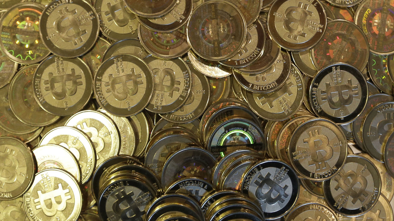 FILE - This April 3, 2013 file photo shows bitcoin tokens in Sandy, Utah.  The website of major bitcoin exchange Mt. Gox is offline Tuesday, Feb. 25, 2014, amid reports it suffered a debilitating theft, a new setback for efforts to gain legitimacy for the virtual currency.