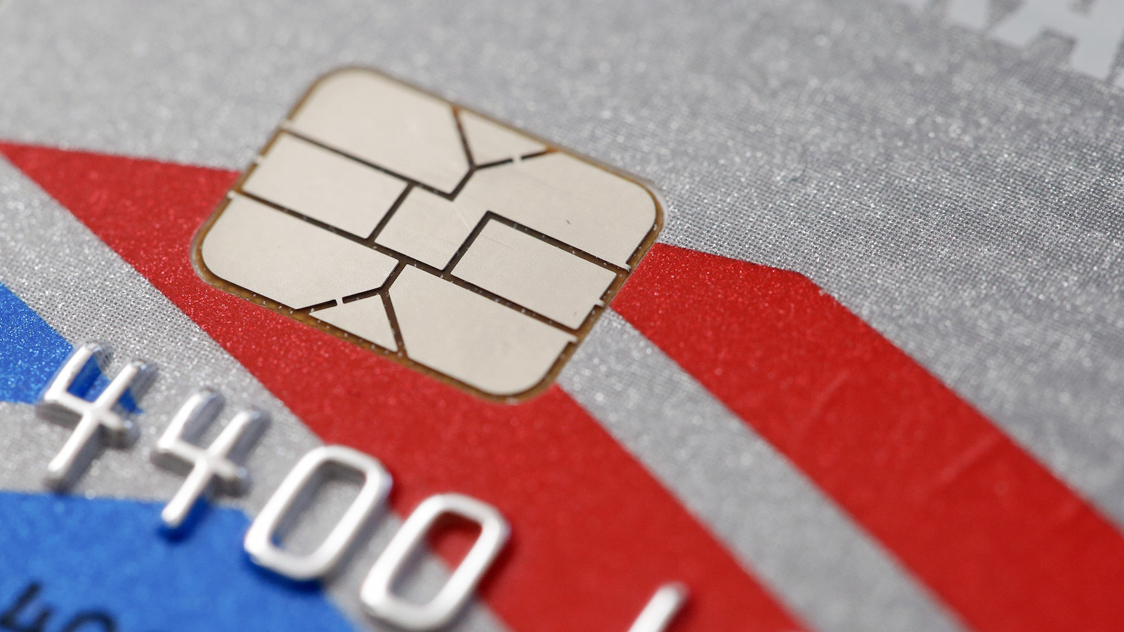 FILE - This Wednesday, June 10, 2015, file photo, shows a chip-based credit card, in Philadelphia. Millions of Americans are getting new credit and debit cards with chip technology and that's causing big headaches for subscription companies that rely on working cards to charge their customers every month.