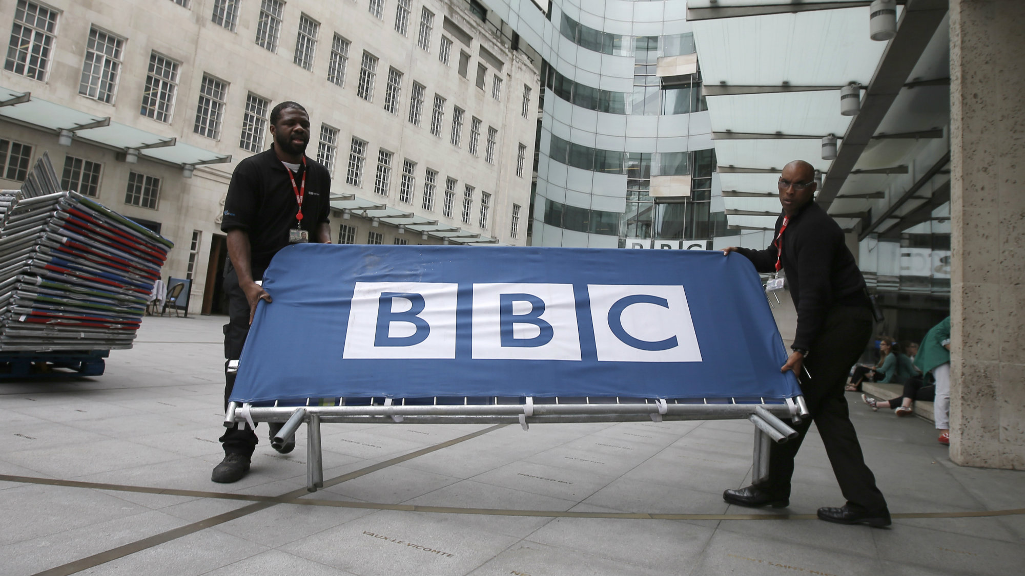 BBC workers place barriers near to the main entrance of the BBC headquarters and studios in Portland Place, London, Britain, July 16, 2015.