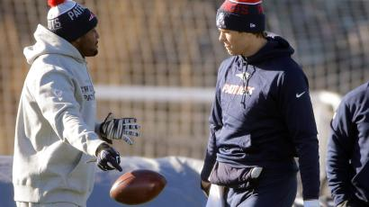 New England Patriots quarterback Tom Brady, right, walks onto the field as linebacker Dakota Watson, left, drops the ball at the start of an NFL football practice, Wednesday, Jan. 6, 2016, in Foxborough, Mass. The Patriots are to host an NFL divisional playoff game Jan. 16, 2016 in Foxborough, Mass.
