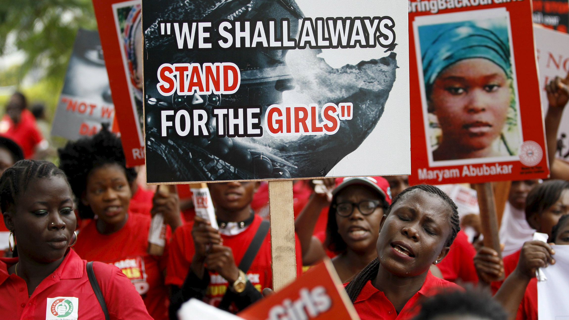 Bring Back Our Girls (BBOG) campaigners hold banners as they walk during a protest procession marking the 500th day since the abduction of girls in Chibok, along a road in Lagos August 27, 2015