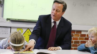 Cameron and child with head on desk.