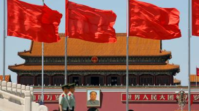 Paramilitary solders stand guard at Tiananmen Square where the portrait of late Chinese chairman Mao Zedong is seen, on the 50th anniversary of the start of the Cultural Revolution in Beijing