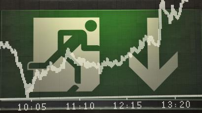 The share price index DAX board is seen in front of an emergency exit sign at Frankfurt's stock exchange, October 8, 2008. European shares were down only slightly by midday on Wednesday after a dramatic coordinated rate cut by the world's top central banks lifted stocks from five-year lows hit early in the day. Picture is taken with multiple exposure function of the camera. REUTERS/Kai Pfaffenbach(GERMANY)