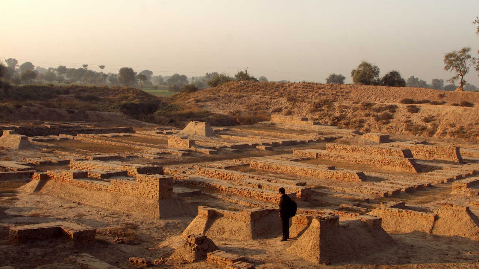 A picture dated 14 December 2013 shows a Pakistani tourist visiting the remains of the ancient Indus valley civilization in Harappa, Pakistan. Some 4,500 years ago, a remarkable civilization existed in the vast plain of the Indus river and its tributaries. It dominated an approximate area of 1,100,700 square kilometers from the foothill of the Himalaya to the Arabian sea. Among hundreds of ancient settlements bearing imprints of this civilization, Harappa and Mohenjodaro were two important urban centers. A series of archaeological excavations at Harappa - Mohenjodari and other sites since 1921 have brought to light remains of systematically planned cities, towns and settlements offering an outstanding example of well organized society (wide straight roads, well planned houses with elaborate underground system of drainage).