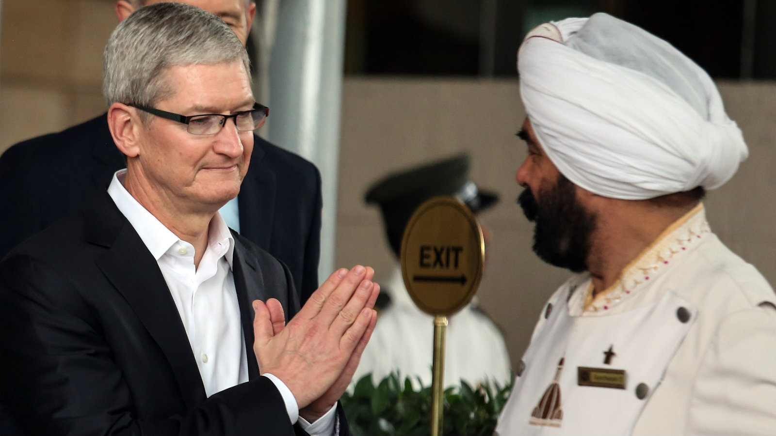 Apple Chief Executive Officer Tim Cook (L) leaves the city hotel in Mumbai, on the first day of his visit to India, 18 May 2016. According to reports Tim Cook is on a four day visit to India during which he will meet with Prime Minister Narendra Modi, Tata Group Chairman Cyrus Mistry and Indian film actor, Shah Rukh Khan.