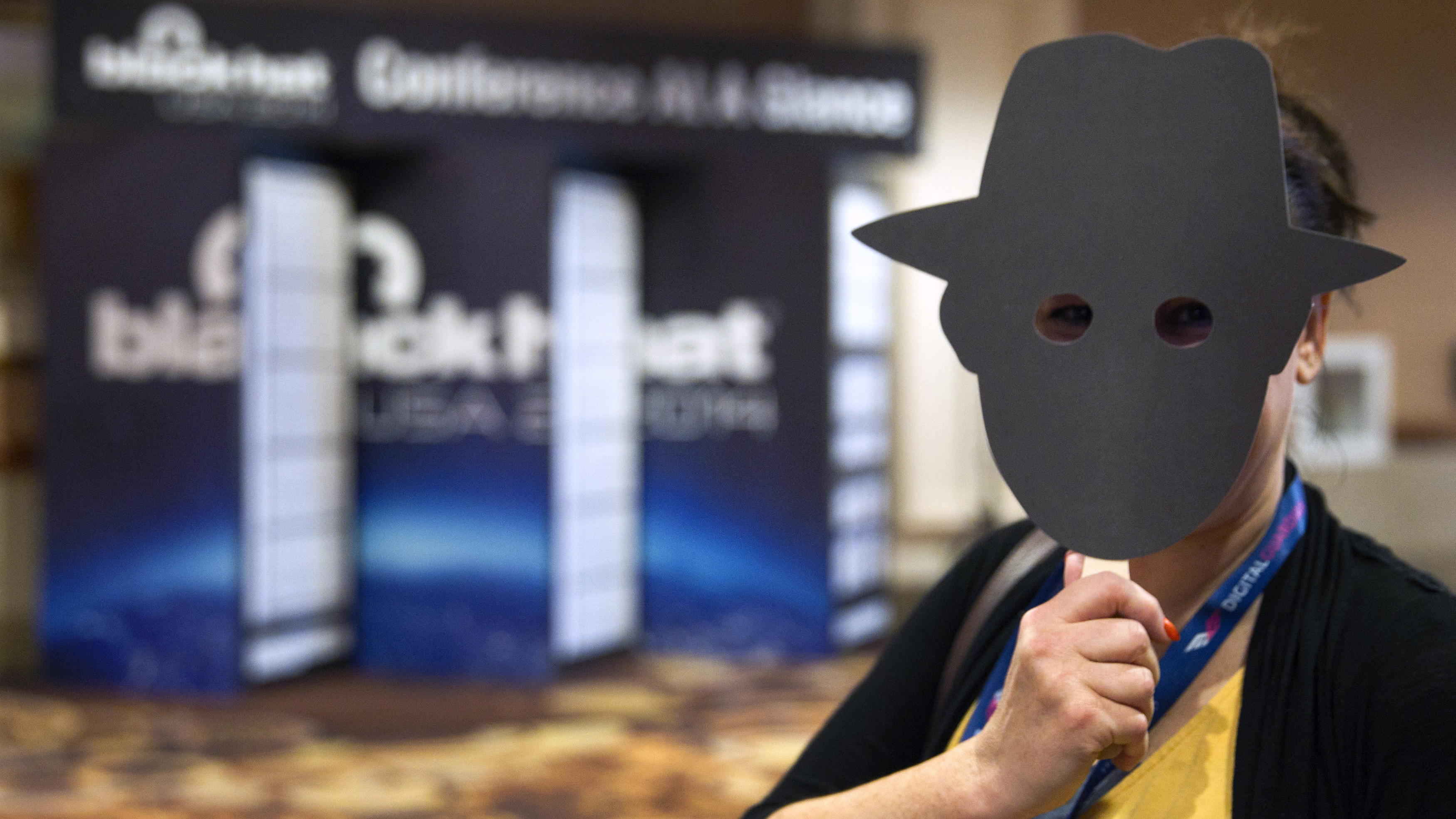 "Tani Currin, marketing events manager for computer security software and hardware developer Sophos, holds an ""anti-selfie"" mask during the Black Hat USA 2014 hacker conference at the Mandalay Bay Convention Center in Las Vegas, Nevada August 5, 2014. The mask is part of a privacy awareness marketing campaign, she said. Sophos is a developer of computer security software and hardware. REUTERS/Steve Marcus (UNITED STATES - Tags: SCIENCE TECHNOLOGY BUSINESS SOCIETY) - RTR41DIB"