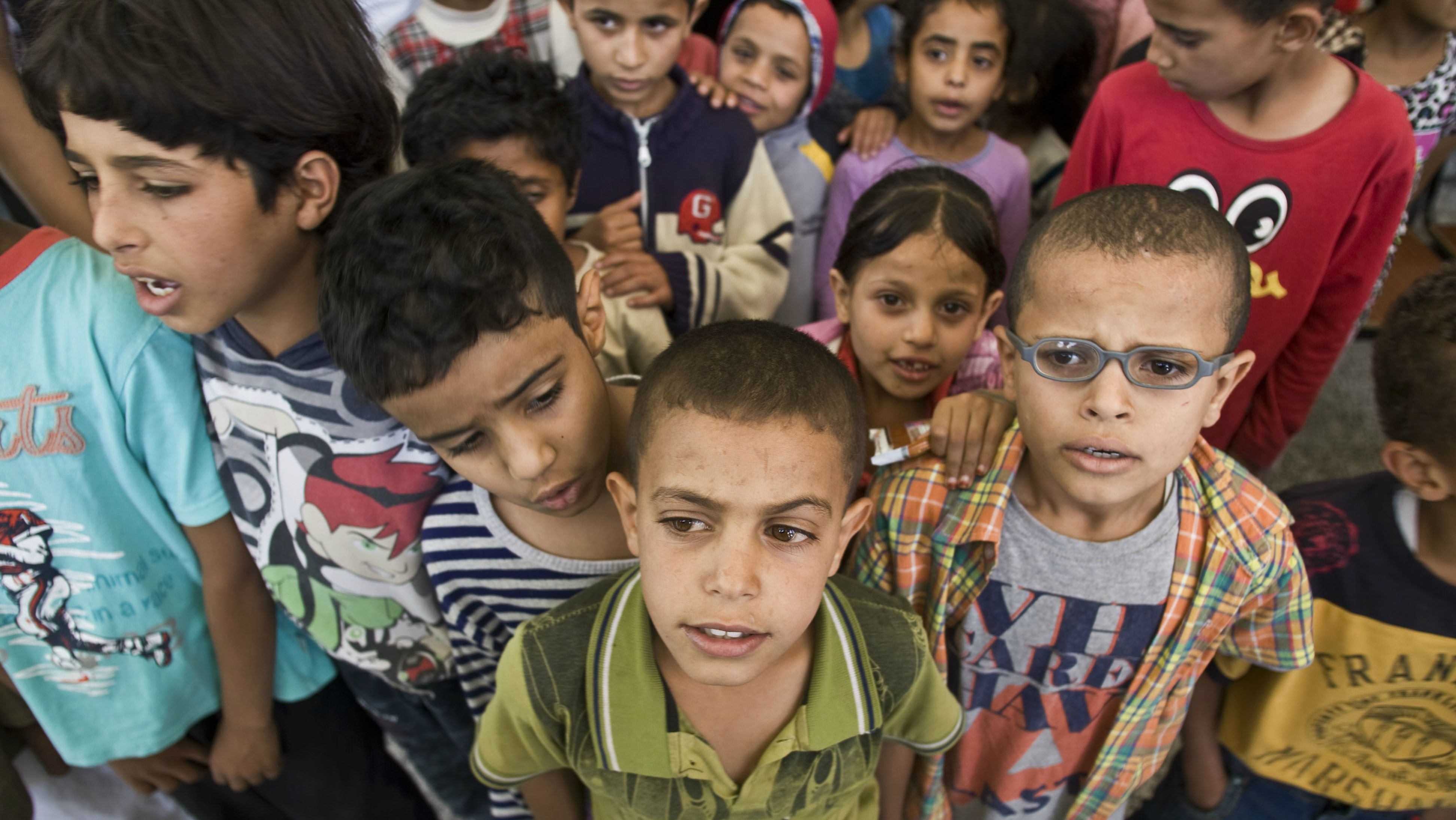 Displaced boys who fled their home after a Saudi-led airstrike destroyed their houses, live in a school in Sanaa, Yemen, Thursday, May 14, 2015. The conflict in Yemen has killed more than 1,400 people - many of them civilians - since March 19, according to the U.N. The country of some 25 million people has endured shortages of food, water, medicine and electricity as a result of a Saudi-led blockade. (AP Photo/Hani Mohammed