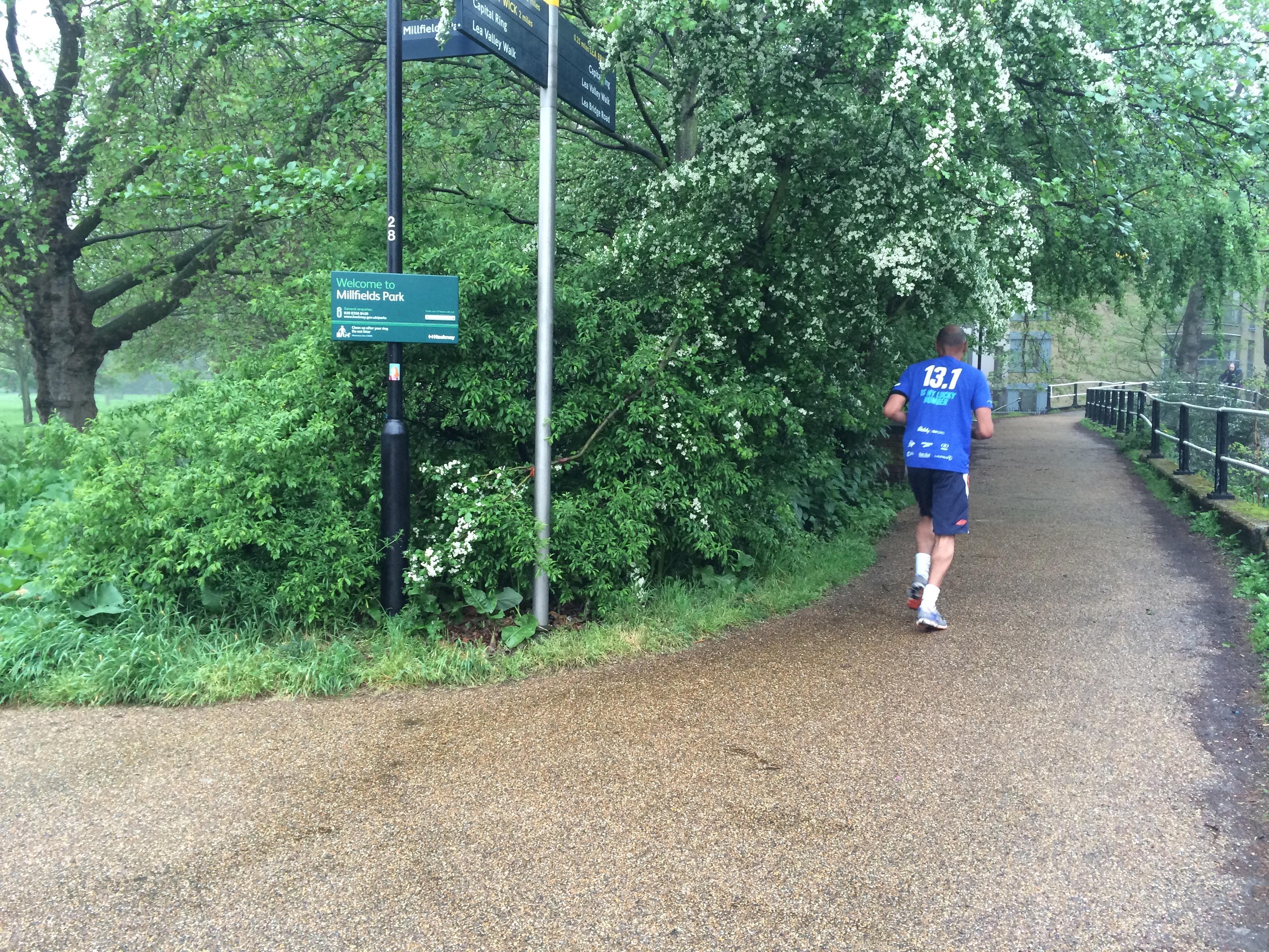 Jogging by Regents Canal, London.