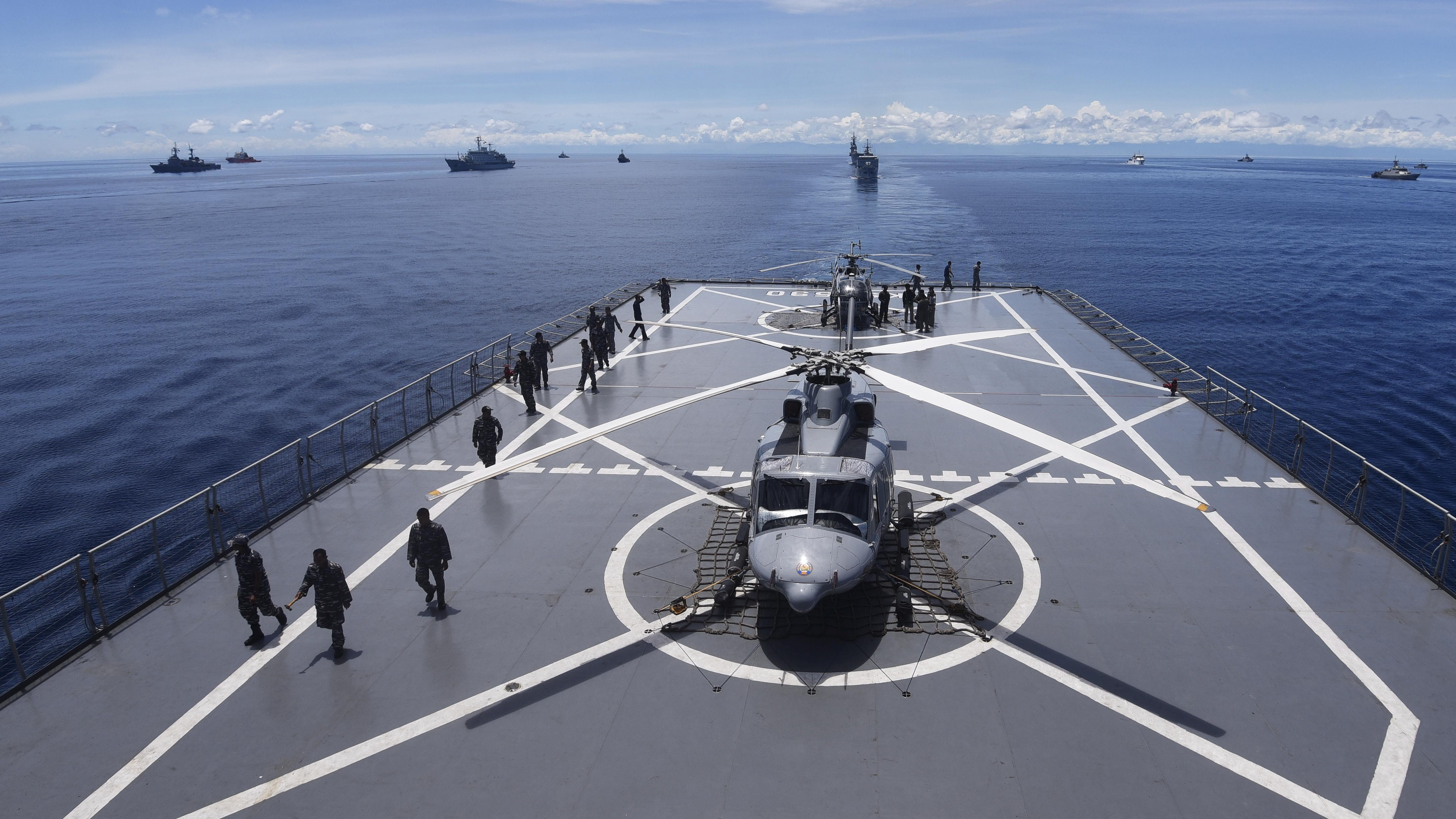 Navy helicopters are seen on Indonesian ship during Komodo Exercise 2016, a 5-day multinational exercise to improve emergency response and strengthen humanitarian relief efforts, near the Mentawai Islands off the coast of West Sumatra, Indonesia