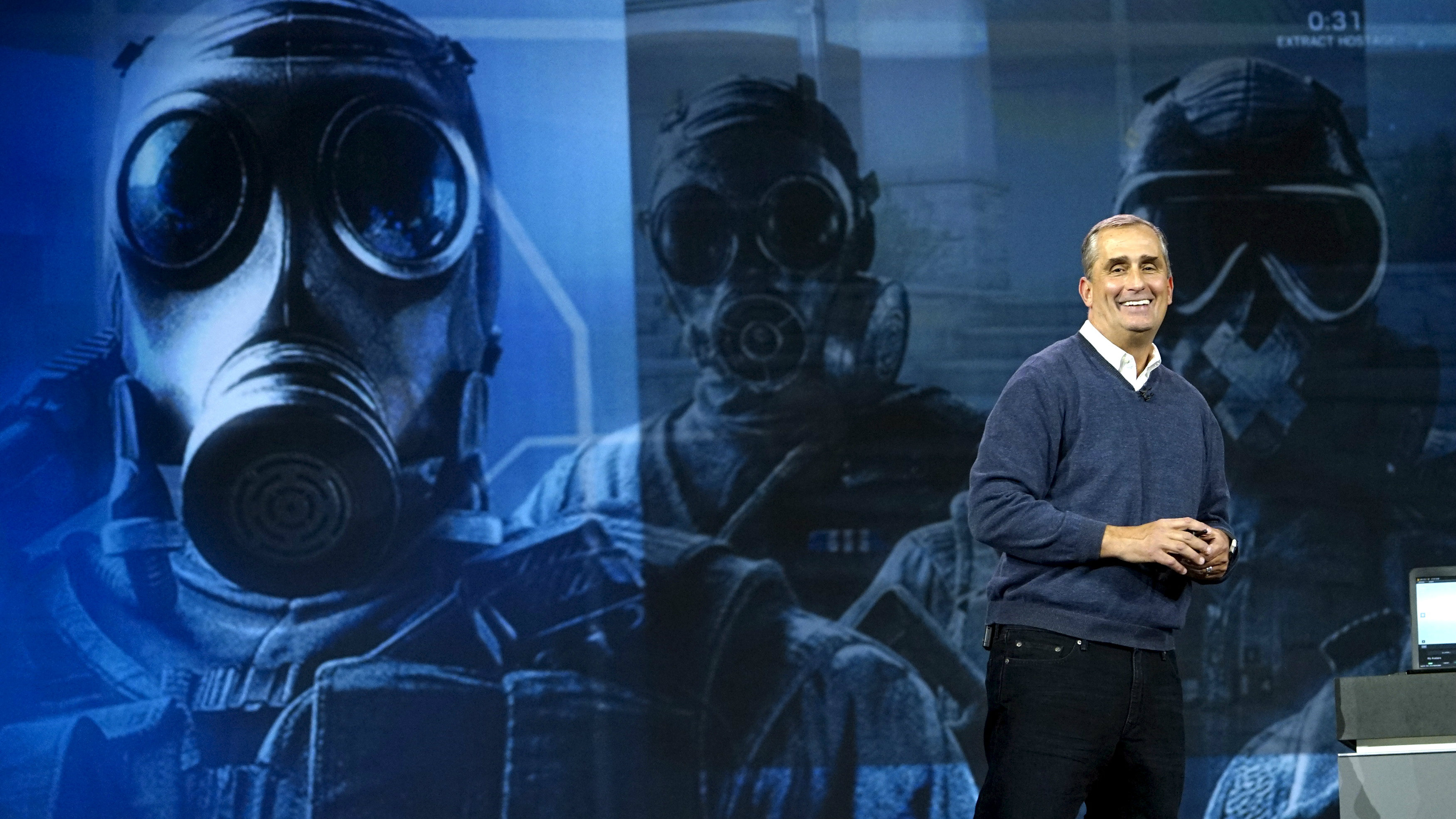 Intel CEO Brian Krzanich smiles in front of a screen showing characters from the computer game Tom Clancy's Rainbow Six Seige during his keynote address at the Consumer Electronics Show in Las Vegas January 5, 2016. REUTERS/Rick Wilking