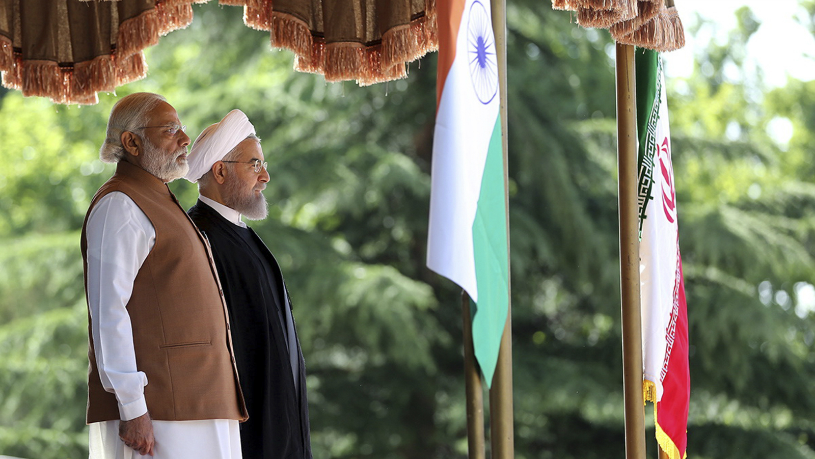 A handout picture made available by Presidential Office of Iran shows Iranian President Hassan Rouhani (R) welcome Indian Prime minister Narendra Modi (L) during a welcome ceremony in Tehran, Iran, 23 May 2016. Prime Minster Modhi is in Tehran on a two day visit, and will discuss trade and security issues with the Iranian President. EPA/PRESIDENTIAL OFFICE OF IRAN / HANDOUT HANDOUT EDITORIAL USE ONLY