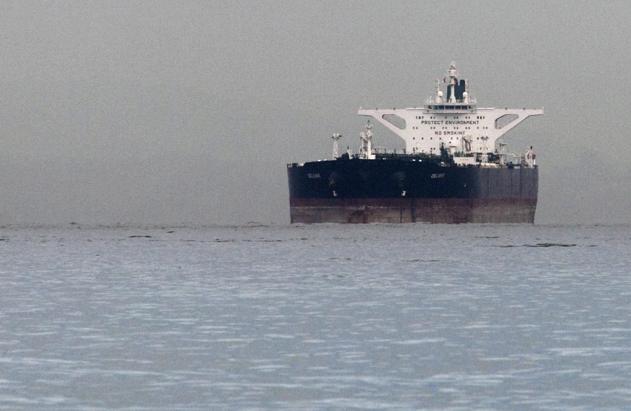 "Malta-flagged Iranian crude oil supertanker ""Delvar"" is seen anchored off Singapore March 1, 2012. Western trade sanctions against Iran are strangling its oil exports even before they go into effect, a U.S. advisory body has found, amid warnings that any shortages will only push up crude prices and strain a weak global economy."