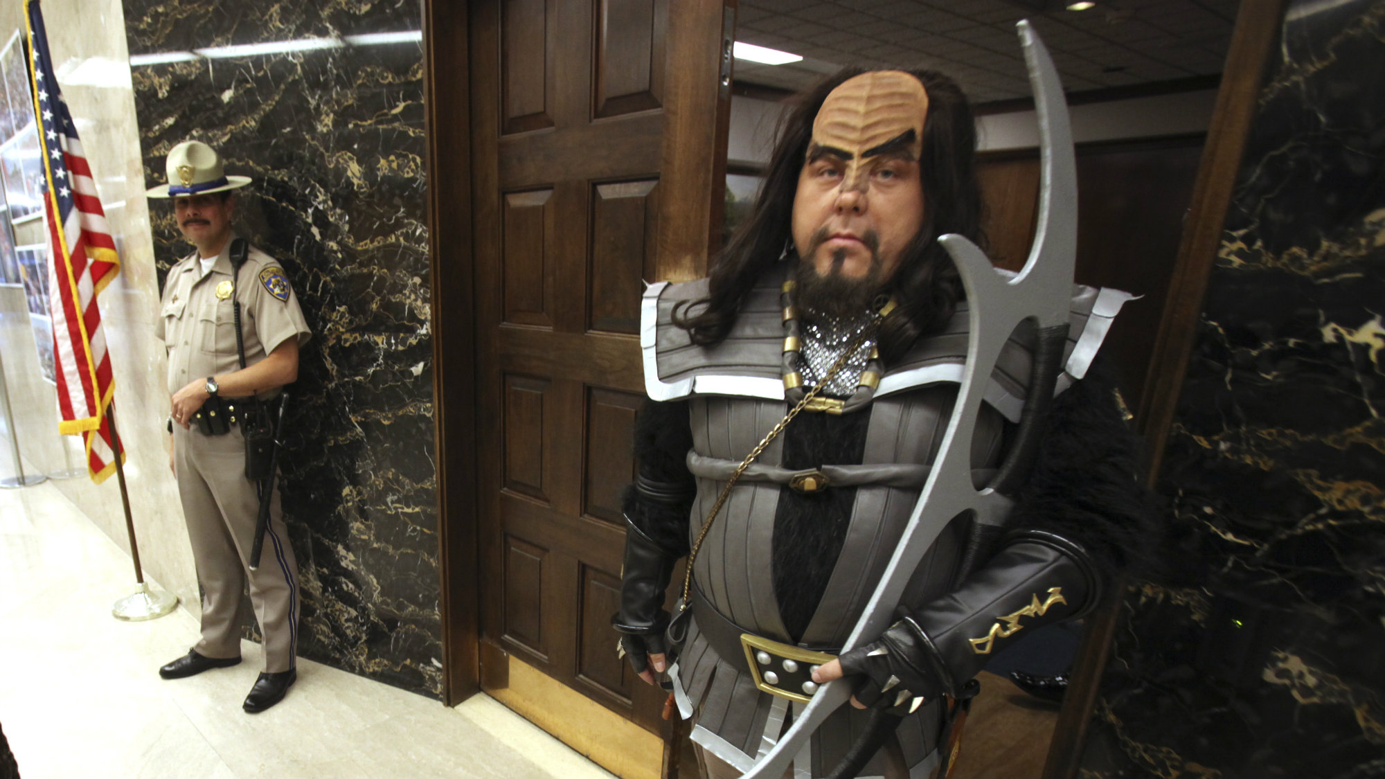 Dressed as a Klingon Commanders, of Star Trek fame, Chris Mumma, gets a glance from California Highway Patrol officer Robert Stevenson, as he leaves the Governor's office at the state Capitol in Sacramento, Calif., Wednesday, Sept. 30, 2009.