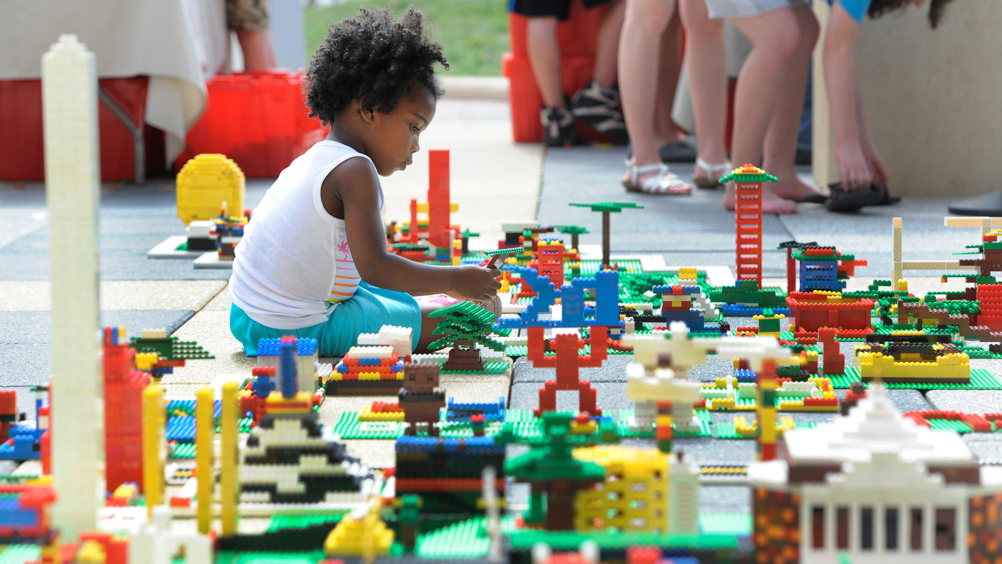 LEGO Maker Glo Banks, of Washington, helps build a 30-by-50-foot map of the United States at the National Maker Faire at the University of the District of Columbia in Washington Saturday, June 13, 2015.