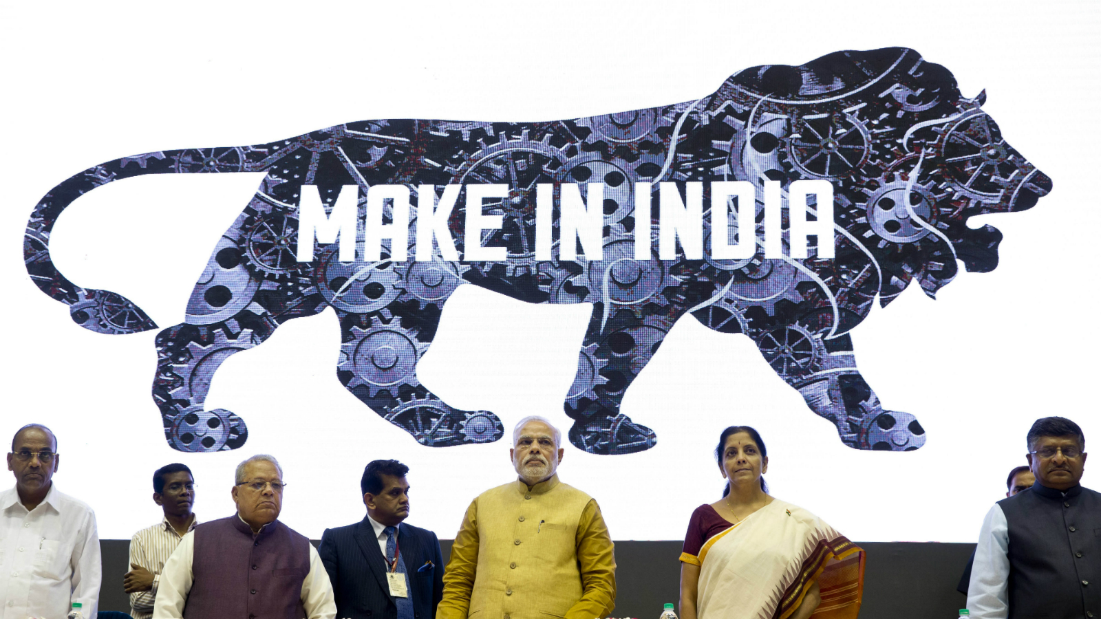 Indian Prime Minister Narendra Modi, center, unveils the logo of 'Make in India' initiative in New Delhi, India, Thursday, Sept. 25, 2014. Scores of business leaders from India and abroad attended the launch of the initiative where in the Indian Prime Minister called on manufacturers across the globe to come and make India a manufacturing hub.