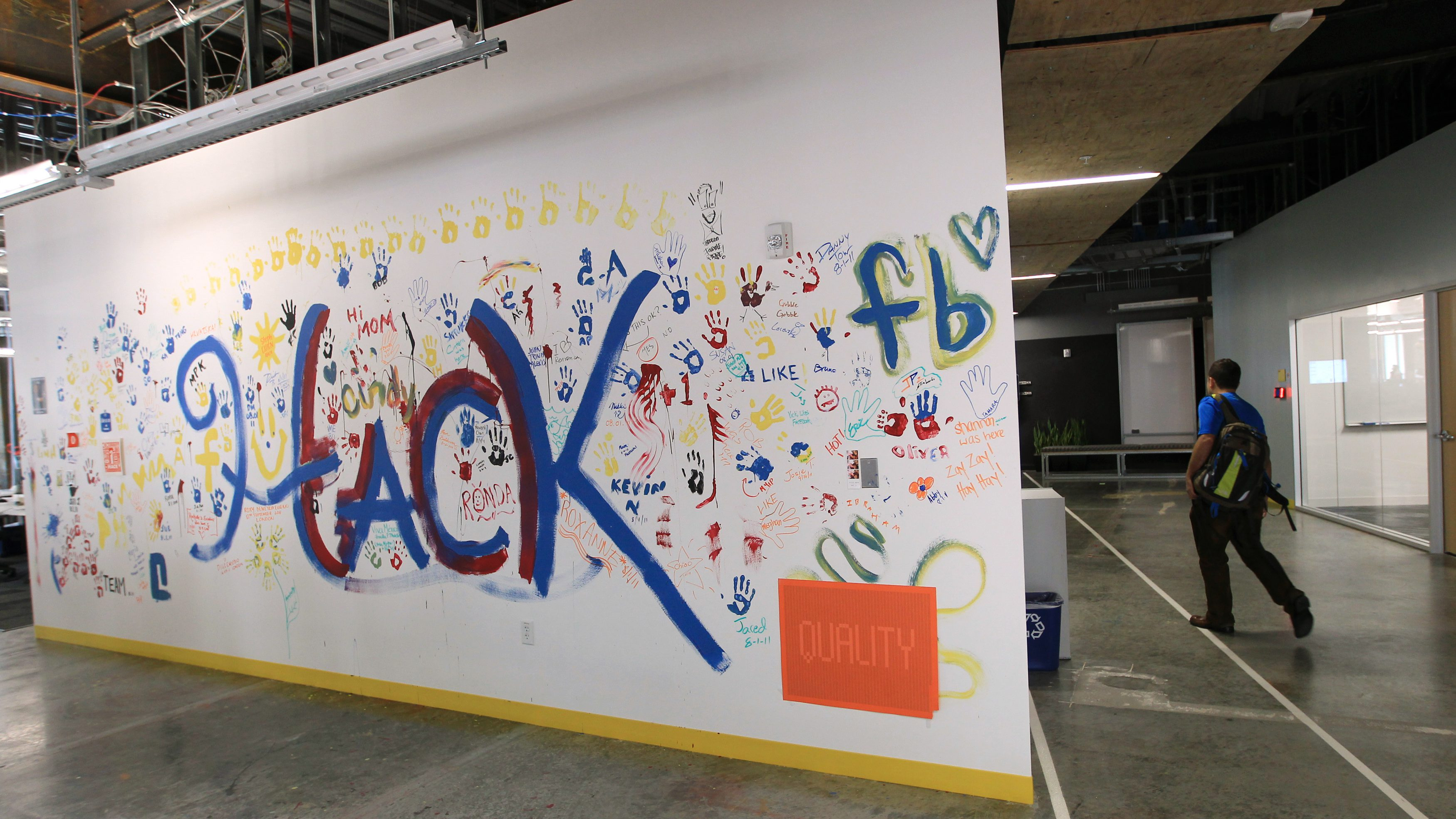 An art and message board is seen in a hallway at the new headquarters of Facebook in Menlo Park, California