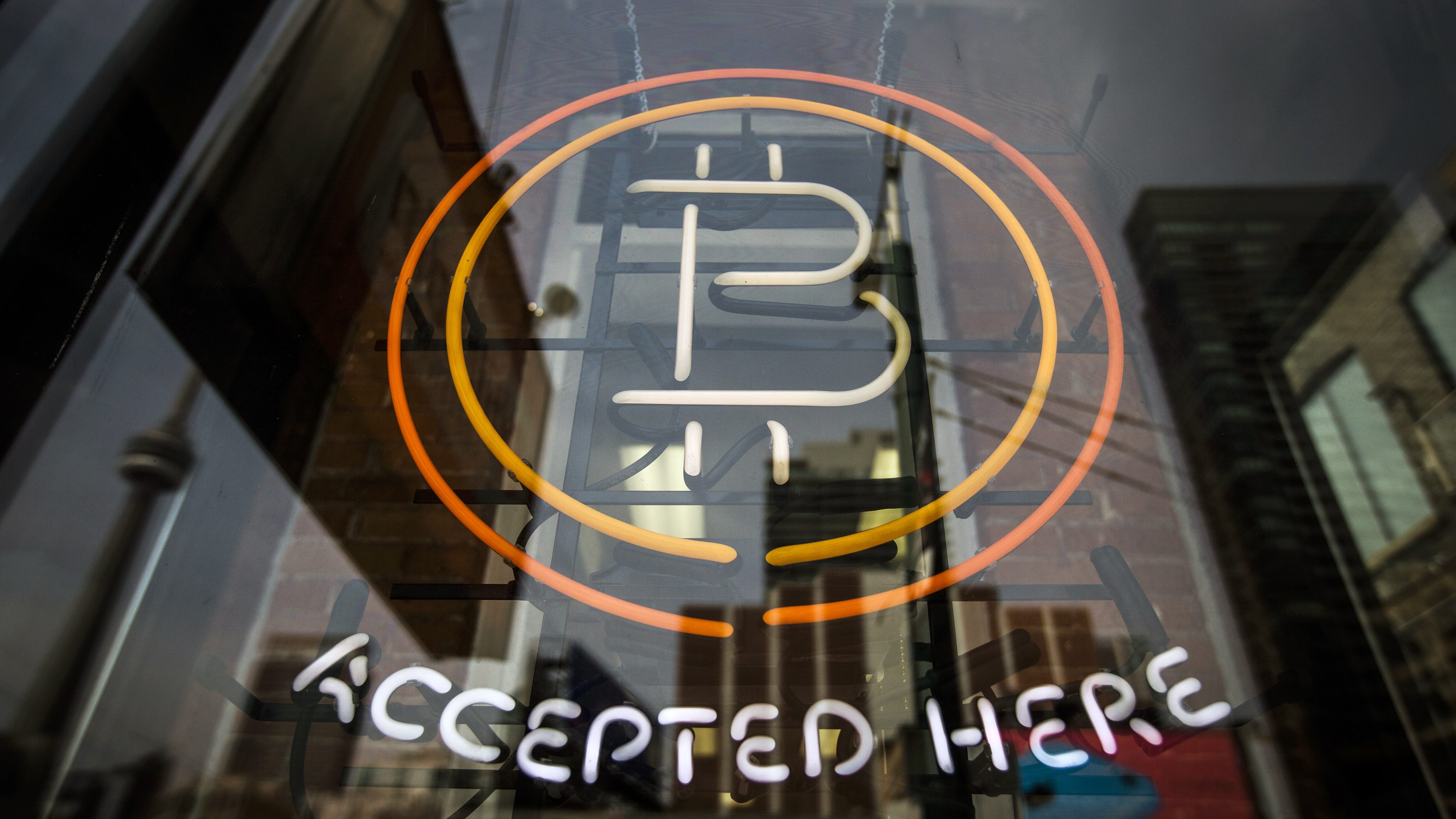 A Bitcoin sign is seen in a window in Toronto