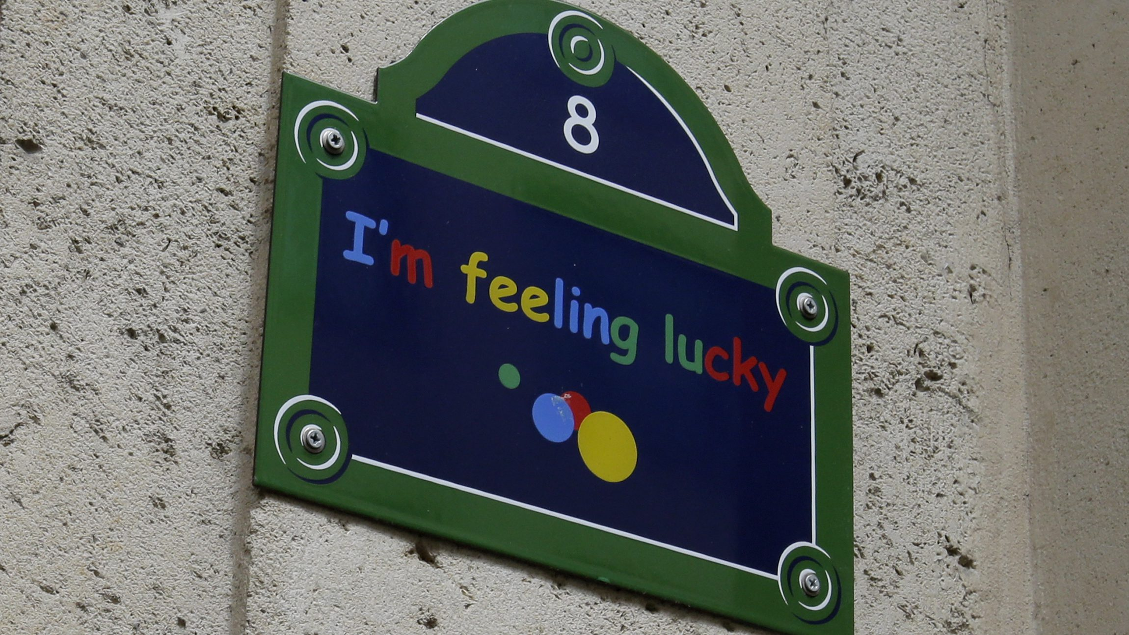 "View of a sign with the message, ""I'm feeling lucky"" on the facade at the entrance of Google's Paris headquarters as French investigators conduct a raid May 24, 2016 as part of a probe over tax payments, a source close to France's finance ministry told Reuters. France is seeking 1.6 billion euros ($1.79 billion) in back taxes from the U.S. Internet giant Google, criticised for its use of aggressive tax optimisation techniques, another source at the finance ministry had said in February."