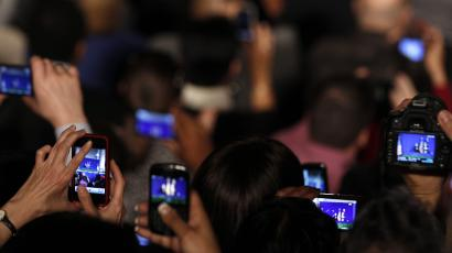 Cameras in audience follow U.S. President Barack Obama as he speaks to the employees of the EPA in Washington