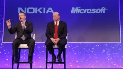Stephen Elop, Nokia CEO, and Steve Ballmer, Microsoft CEO, on stage in 2011.