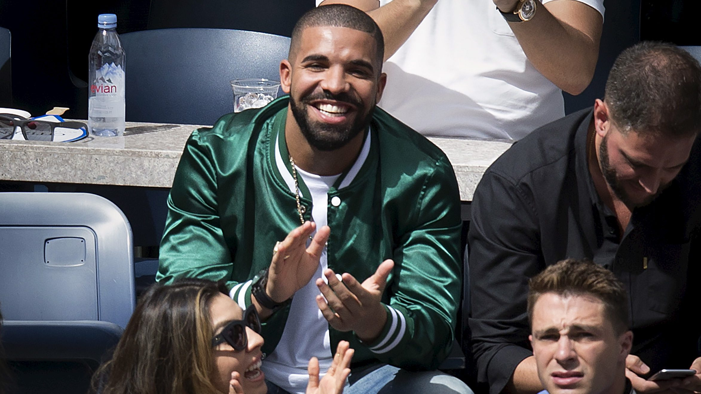 Musician Drake applauds as his image is displayed on the TV monitors during the Serena Williams, Roberta Vinci match at the U.S. Open Championships tennis tournament in New York, September 11, 2015. Picture taken September 11, 2015.