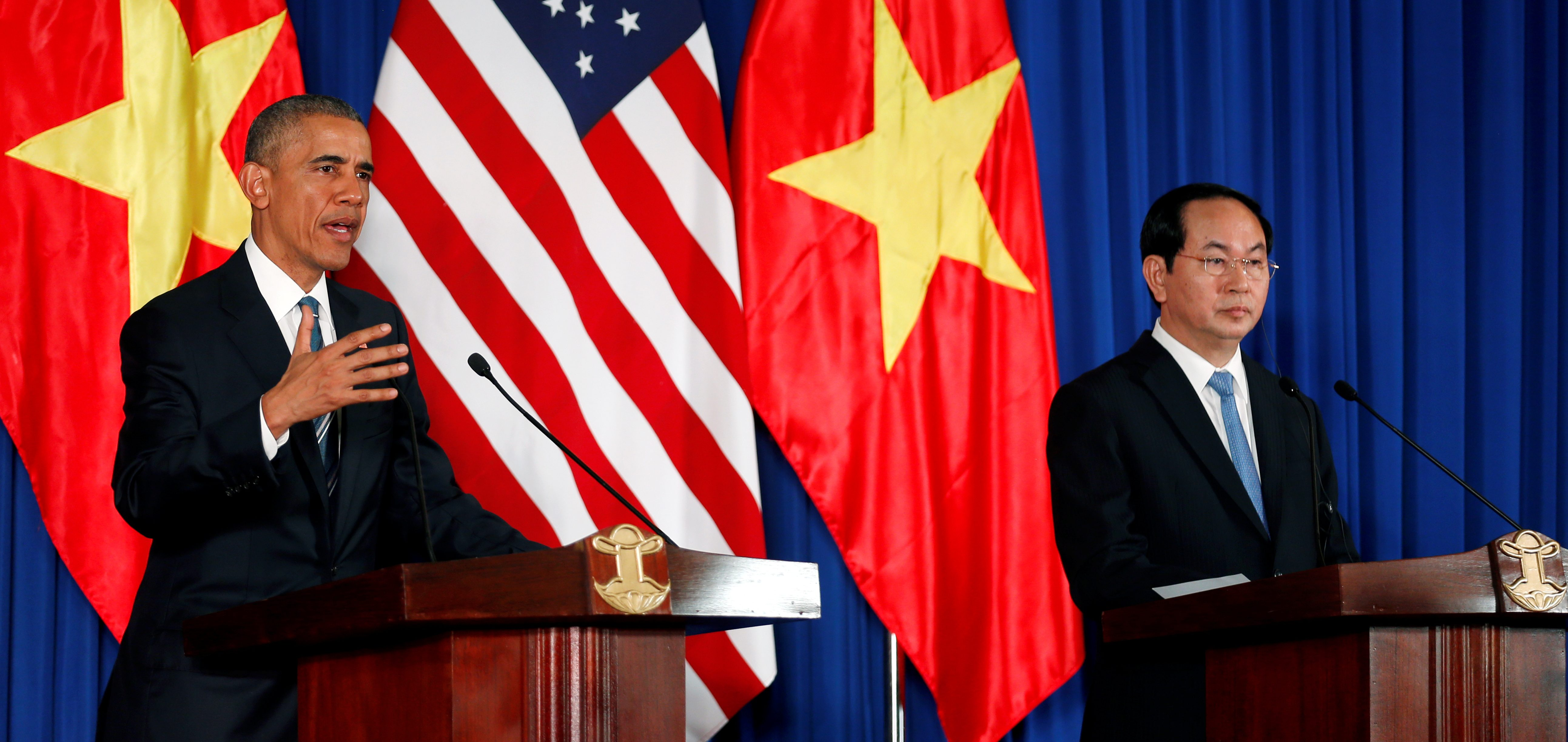 U.S. President Barack Obama attends a press conference with Vietnam's President Tran Dai Quang at the Presidential Palace Compound in Hanoi