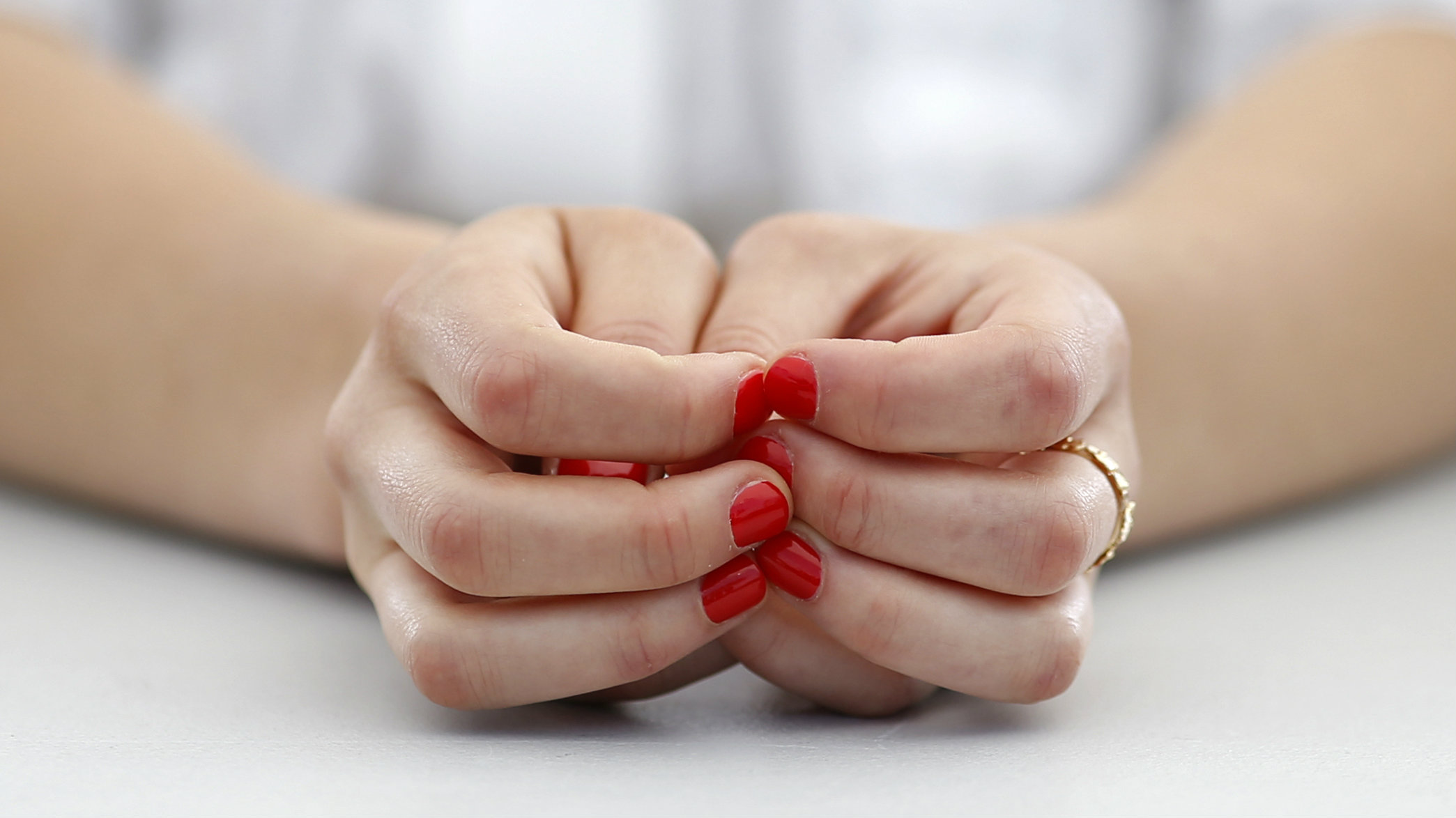 """Cast member Anais Demoustier, with red painted nails, poses during a photocall for the film """"Marguerite et Julien"""" in competition at the 68th Cannes Film Festival in Cannes, southern France, May 19, 2015. REUTERS/Benoit Tessier"""