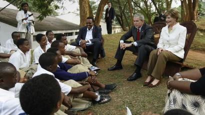 President George W Bush and first lady Laura Bush talk to students in Kigali about abstinence. in 2008.